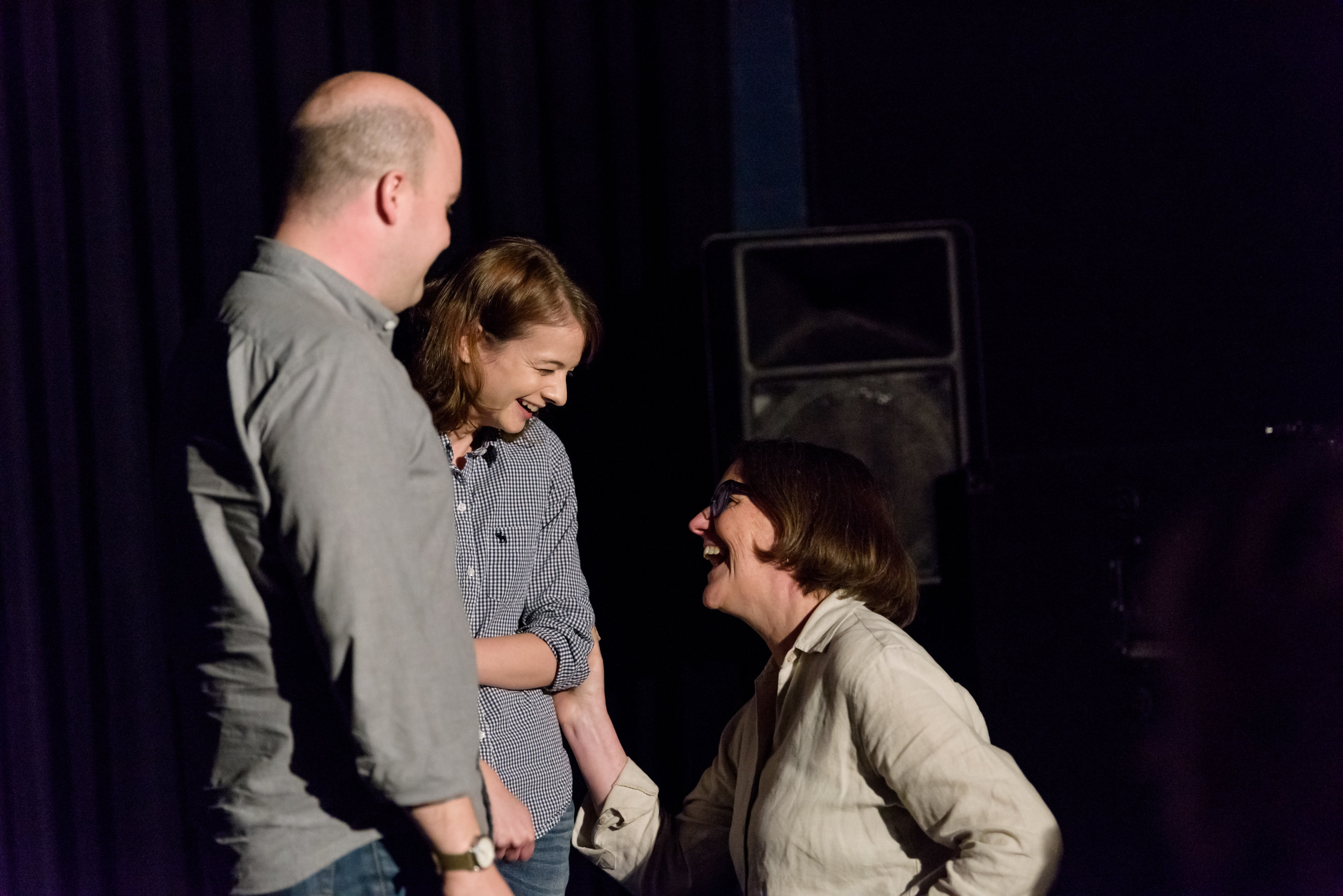 Margaret Rubega shares a laugh with Story Collider producers Erin Barker and Zack Stovall after her story at Real Art Ways in Hartford, CT. Photo by Nick Caito.