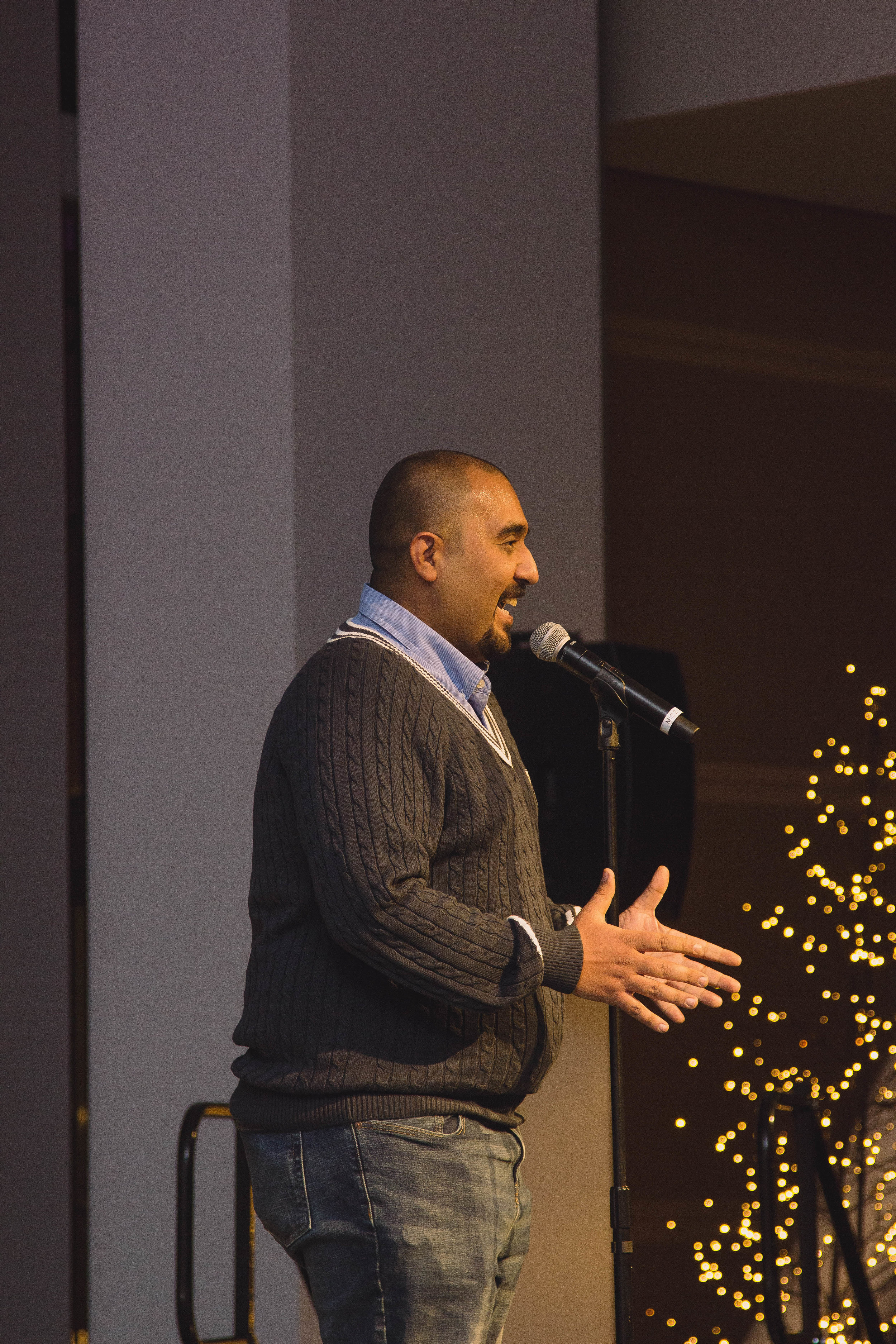 Ali Mustafa shares his story Jack's Urban Meeting Place in Boise, ID at a Story Collider show produced in partnership with Micron School of Materials Science and Engineering in November, 2018. Photo by Lauren Branch.