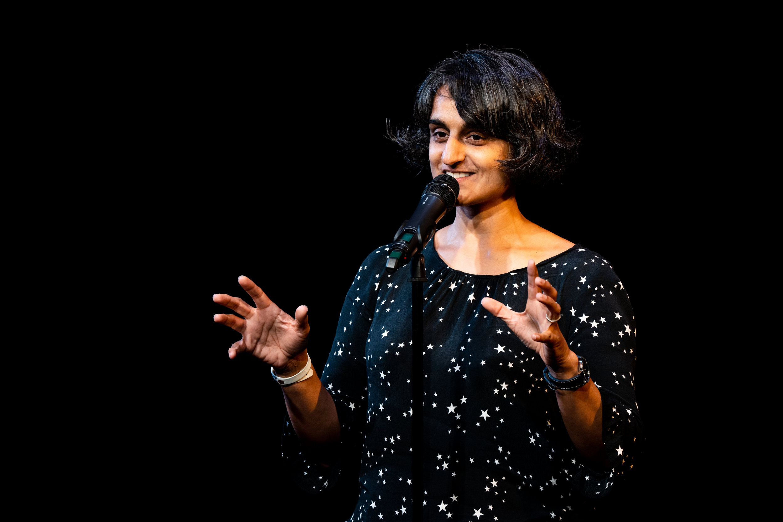 Parmvir Bahia shares her story on The Story Collider stage at Caveat in NYC in October, 2018. The show was presented in partnership with the RockEDU and ASBMB's SciOut 2018 un-conference. Photo by Zhen Qin.