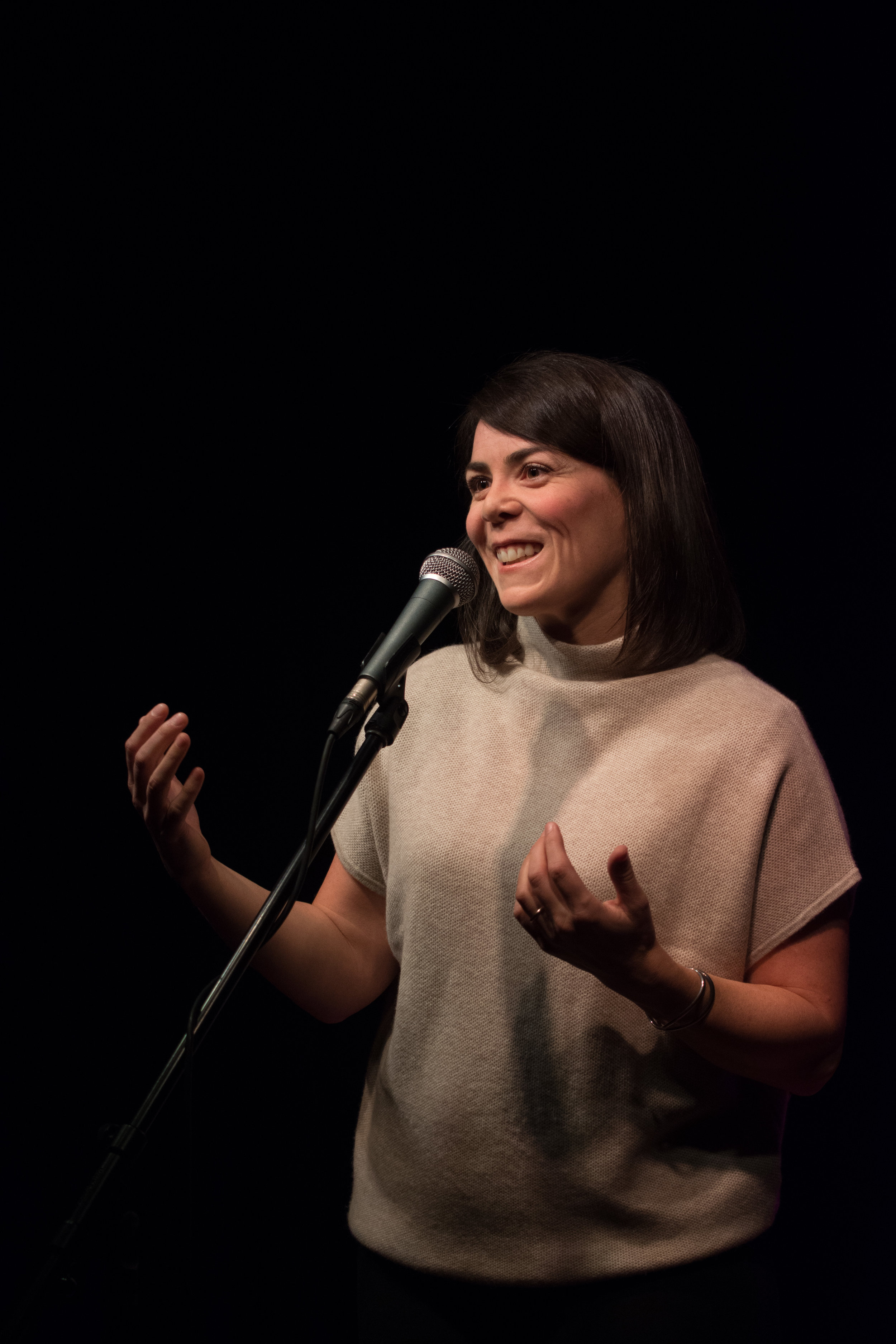Laura Spink shares her story on our Story Collider Home Stage at Burdock Brewery in Toronto, ON in October 2018. Photo by Stacey McDonald.
