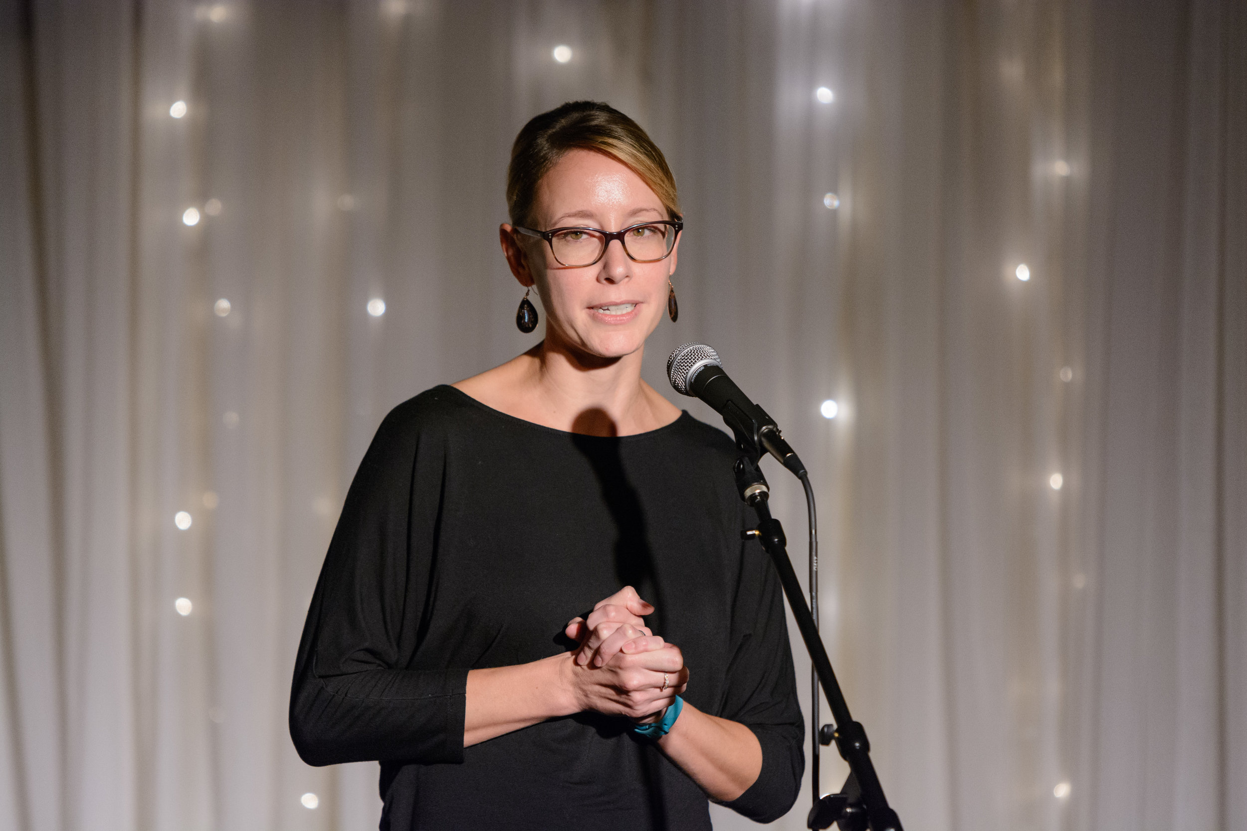 Sarah Fankhauser shares her story on the Story Collider stage at Highline Inn Ballroom in Atlanta, GA in October 2018. Photo by Rob Felt.