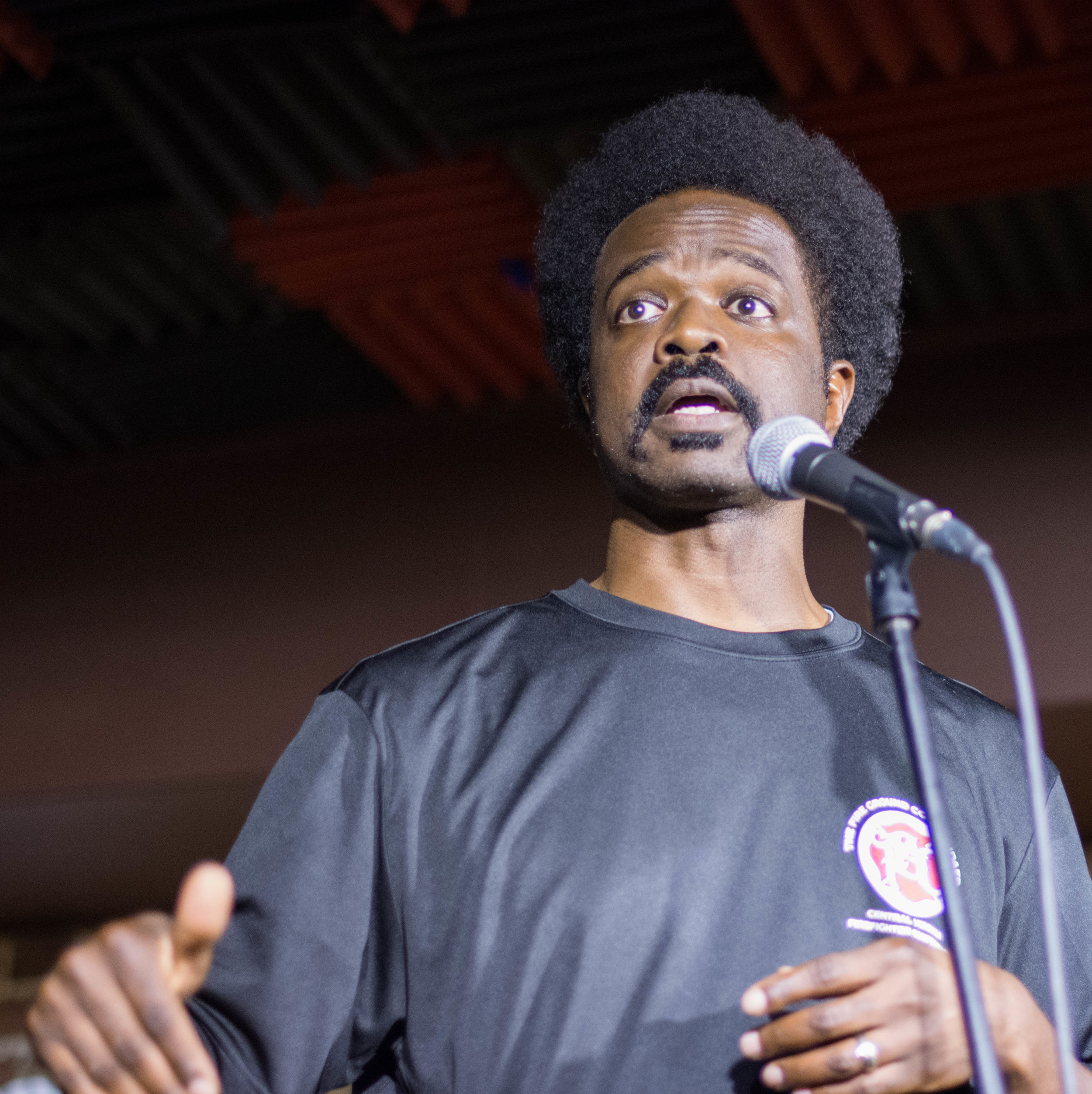 Nick Baskerville shares his story on the Story Collider stage in Washington DC at Bier Baron Tavern in August 2018. Photo by Lauren Lipumba.