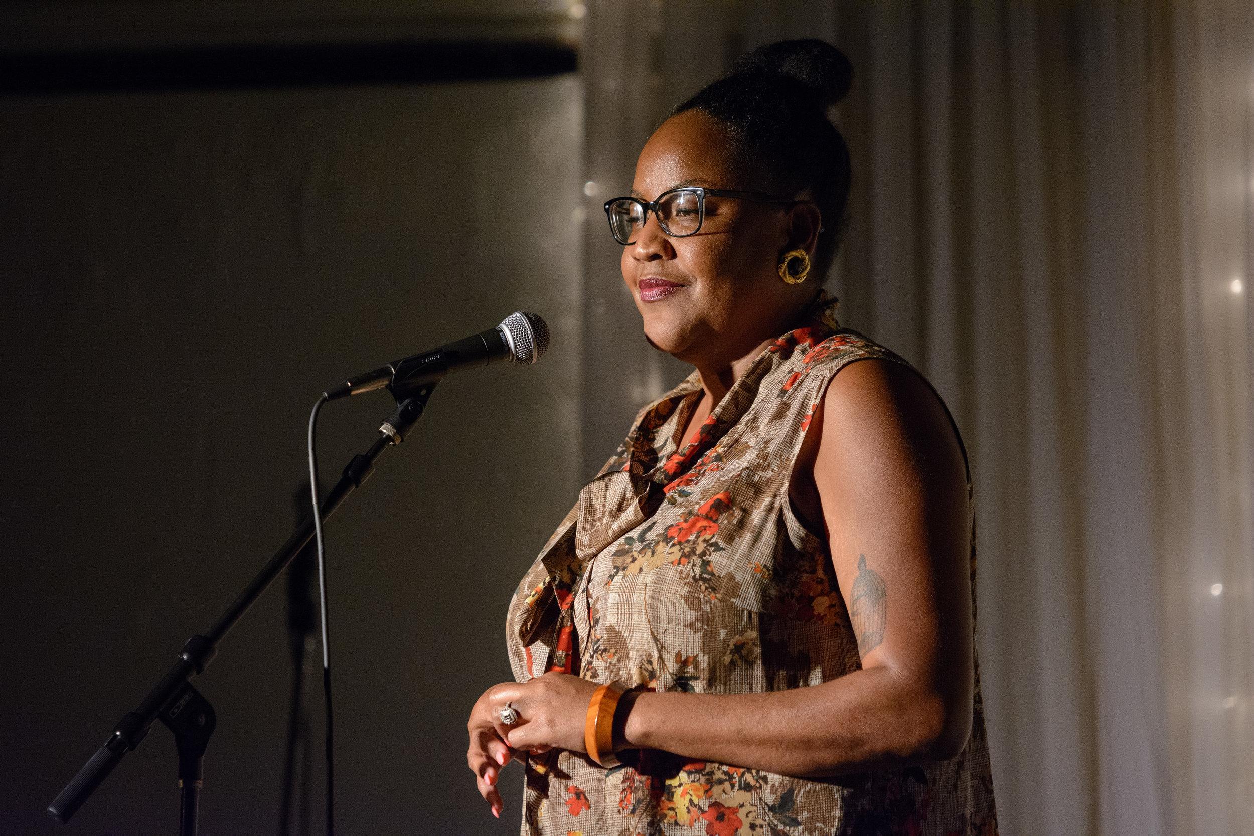 Tricia Hersey shares her story on the Story Collider stage at the Highland Inn and Ballroom in Atlanta, GA in October 2018. Photo by Rob Felt.