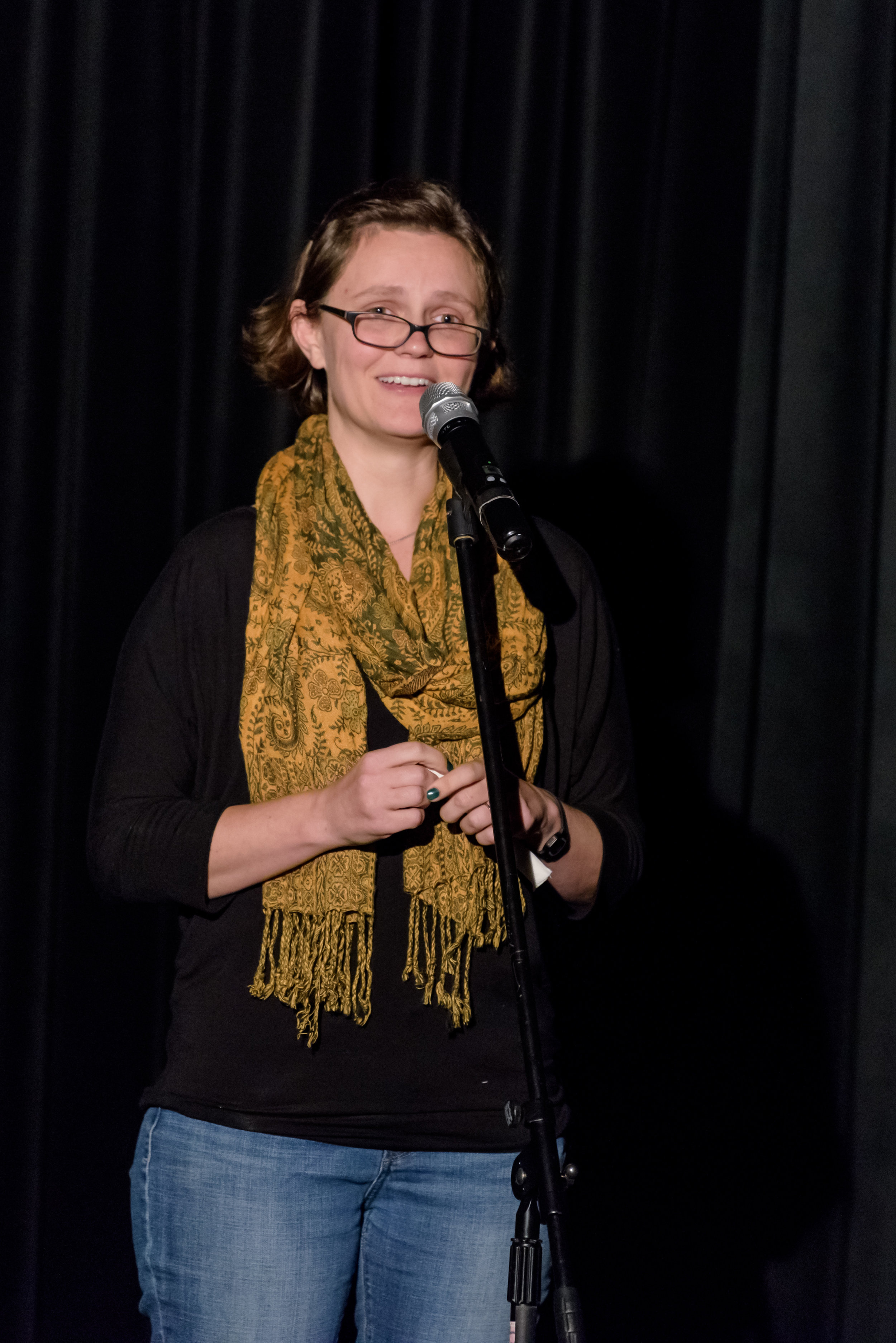 Sarah Hird shares her story on the Story Collider stage at Real Art Ways in Hartford, CT in October 2018. Photo by Nick Caito.