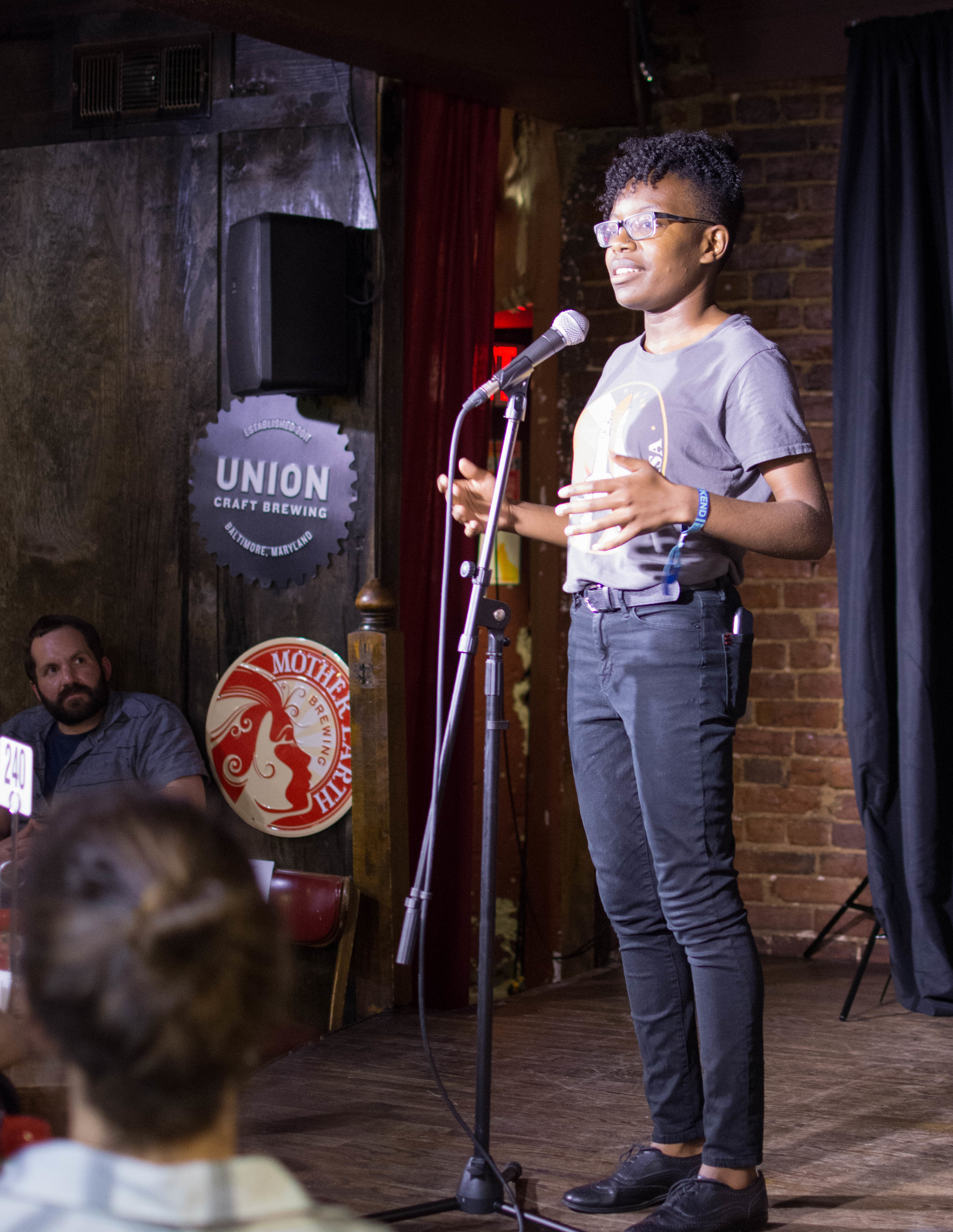 Anicca Harriot shares her story with the Story Collider audience at Bier Baron Tavern in Washington, DC in August 2018. Photo by Lauren Lipuma.