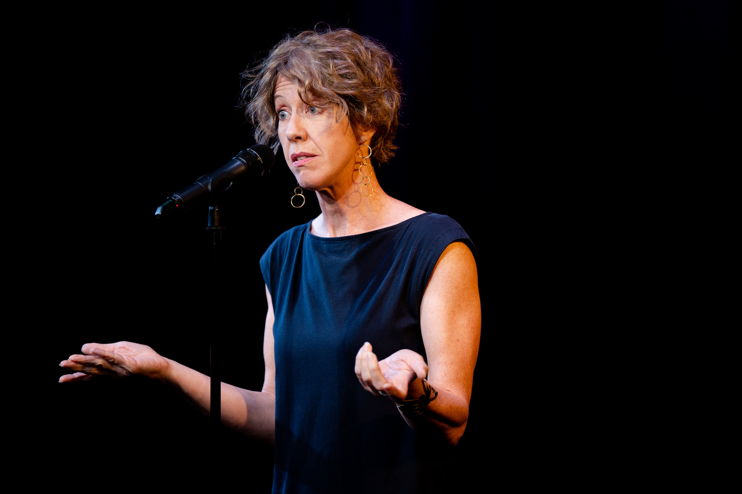 Tracy Rowland shares her story at Caveat in New York City in September 2018. Photo by Zhen Qin.