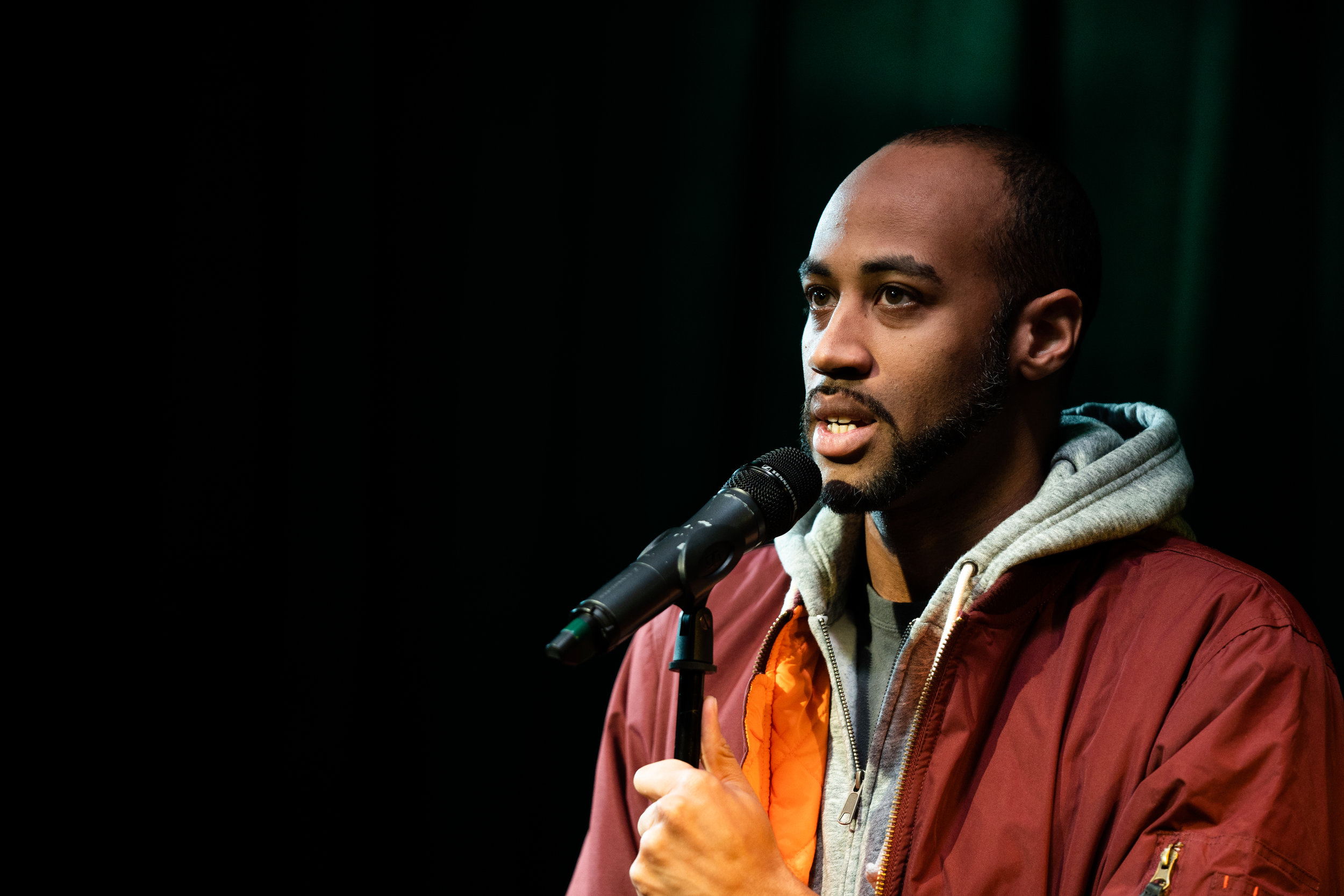 Mike Brown shares his story with The Story Collider at Caveat in NYC in February 2019. Photo by Zhen Qin.