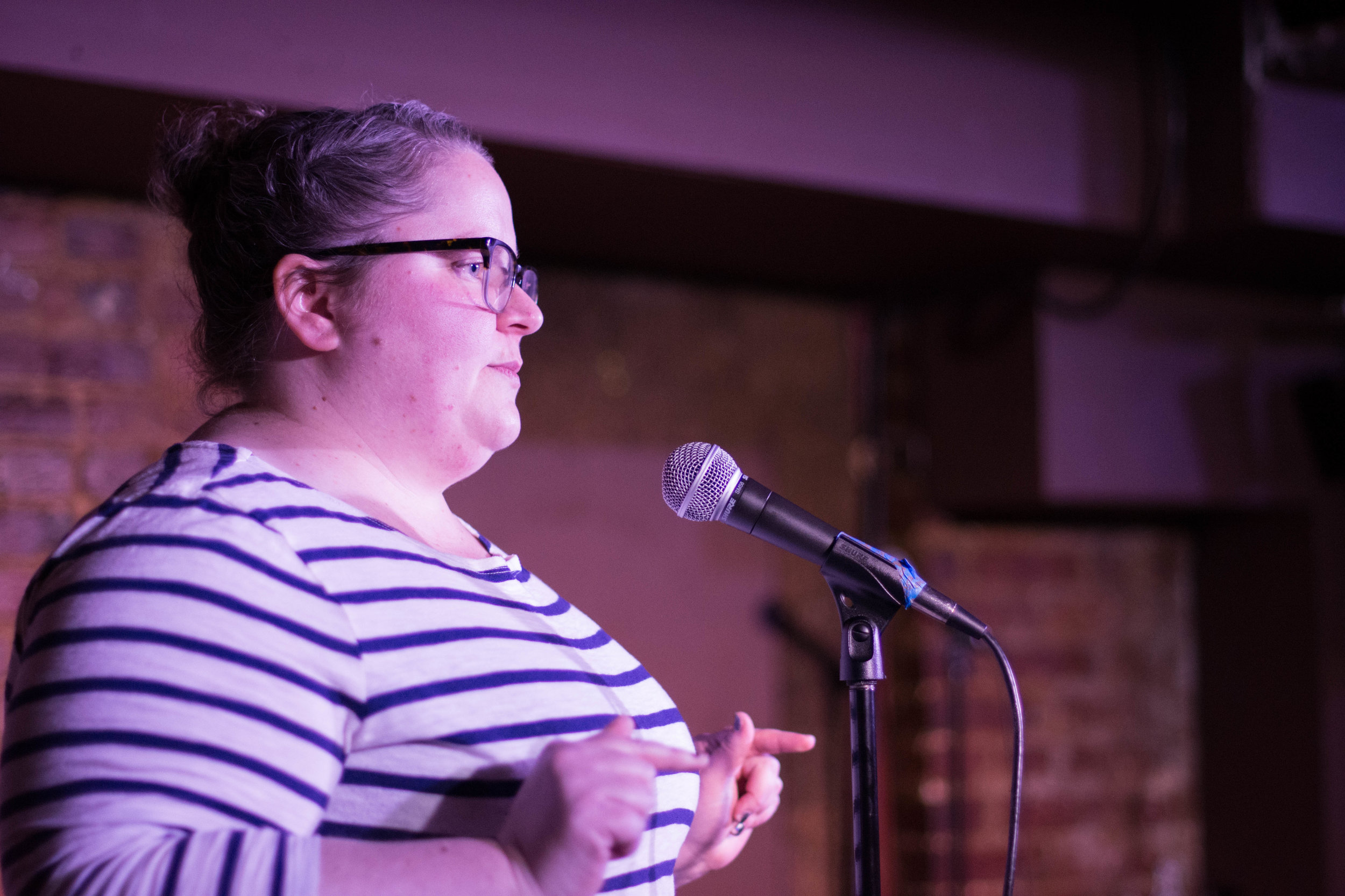Emily Yarrison shares her story with The Story Collider at the Bier Baron Tavern in Washington DC in February 2019. Photo by Lauren Lipuma.