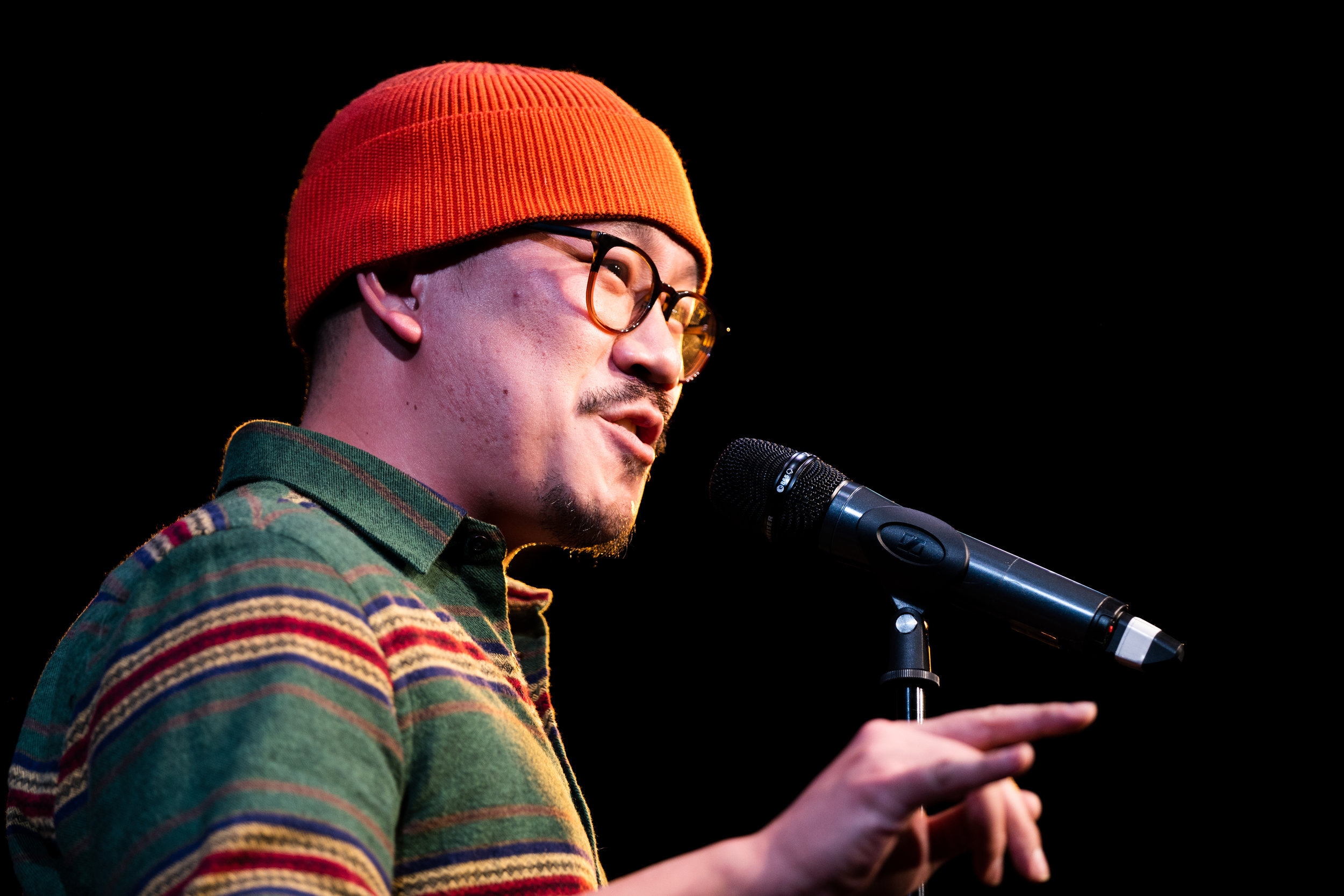 Will Tran shares his story with our Story Collider audience at Caveat in New York City in December 2018. Photo by Zhen Qin.