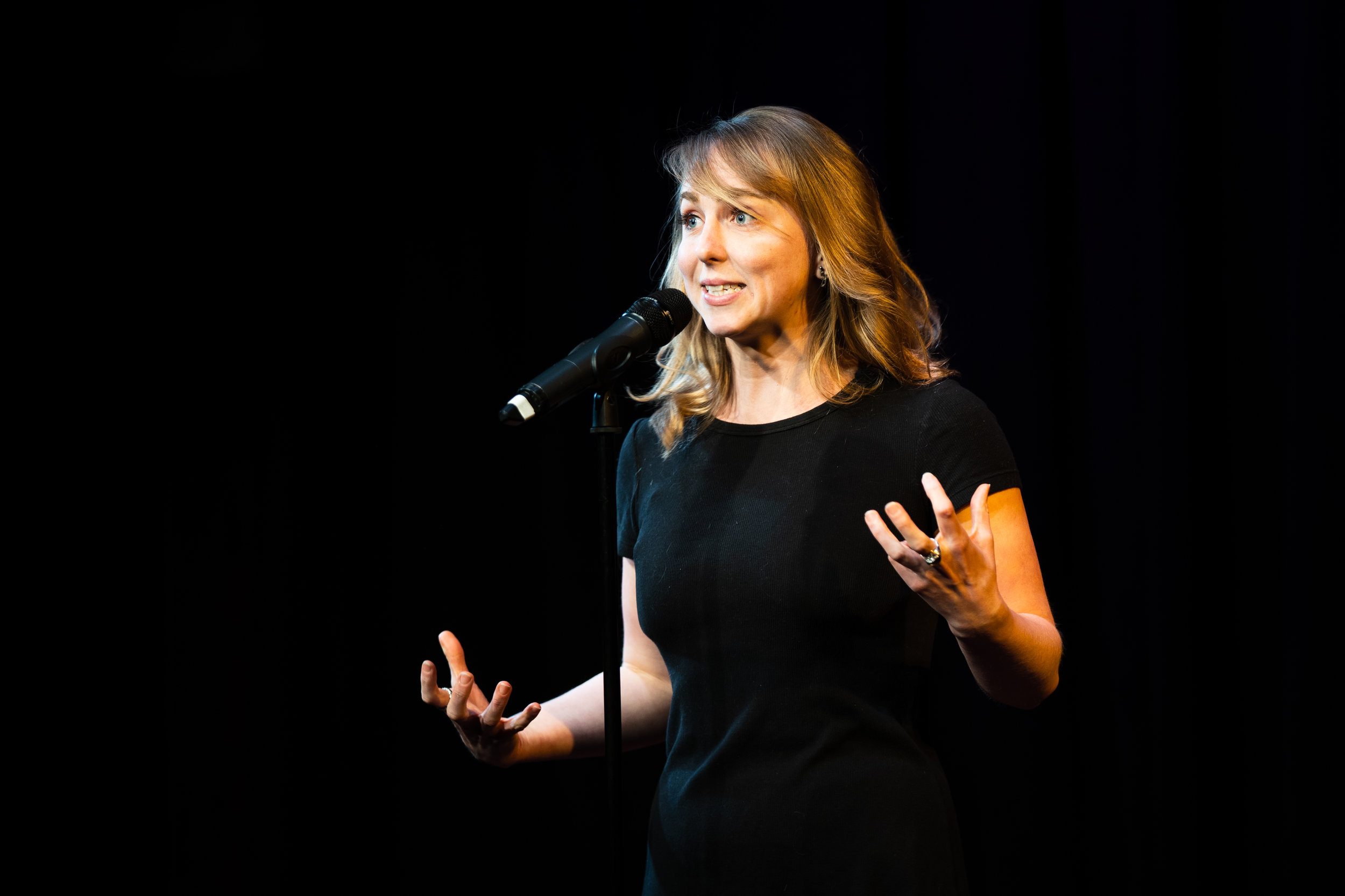 Adrien Behn shares her story with the Story Collider audience at Caveat in New York City in December 2018. Photo by Zhen Qin.