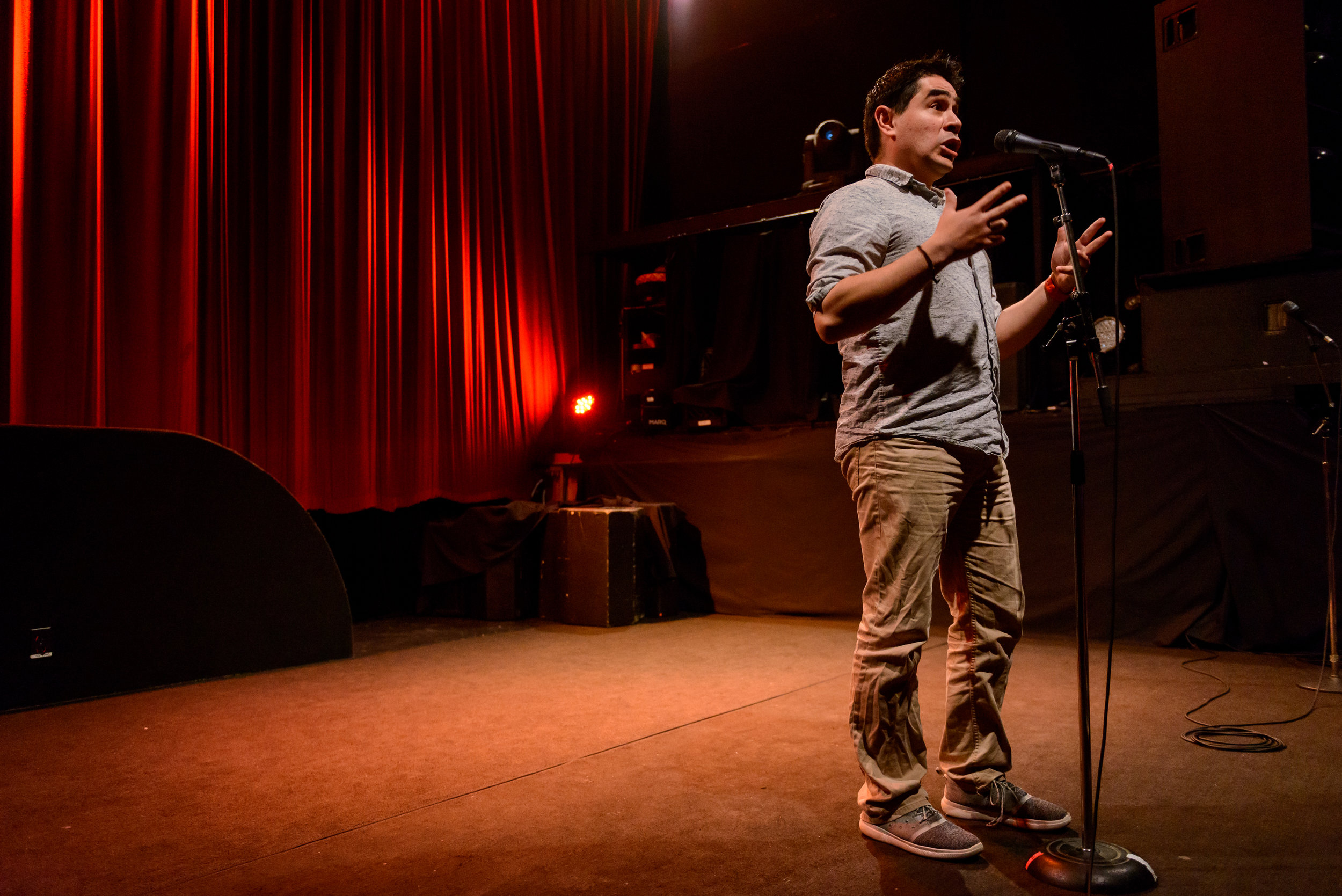 Rodrigo Solis shares his story with the Story Collider audience at Fox Cabaret in Vancouver, BC in April 2019. Photo by Rob Felt.