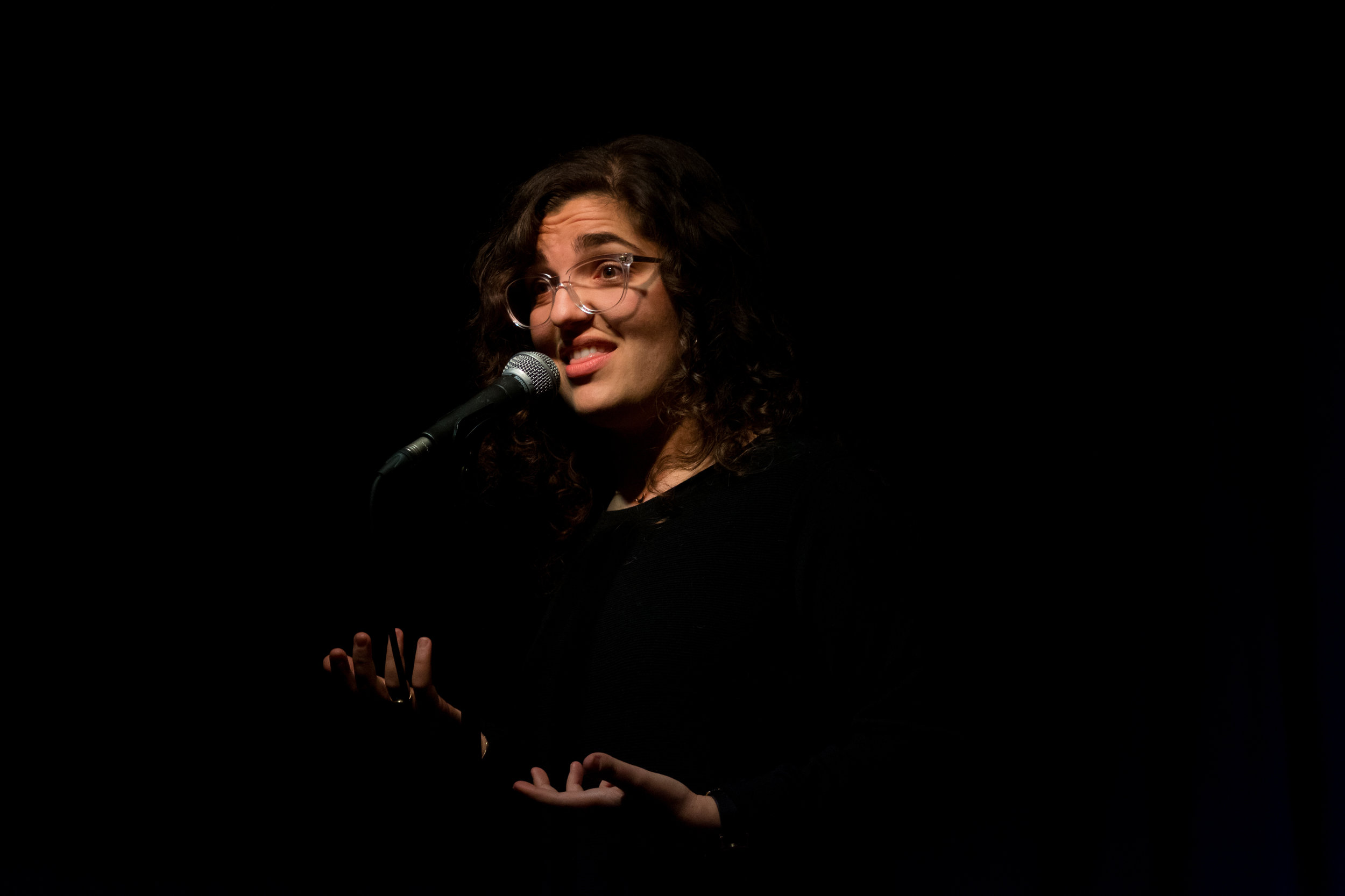 Laura Crocco shares her story with the Story Collider audience at Burdock in Toronto, ON in April 2019. Photo by Stacey McDonald.