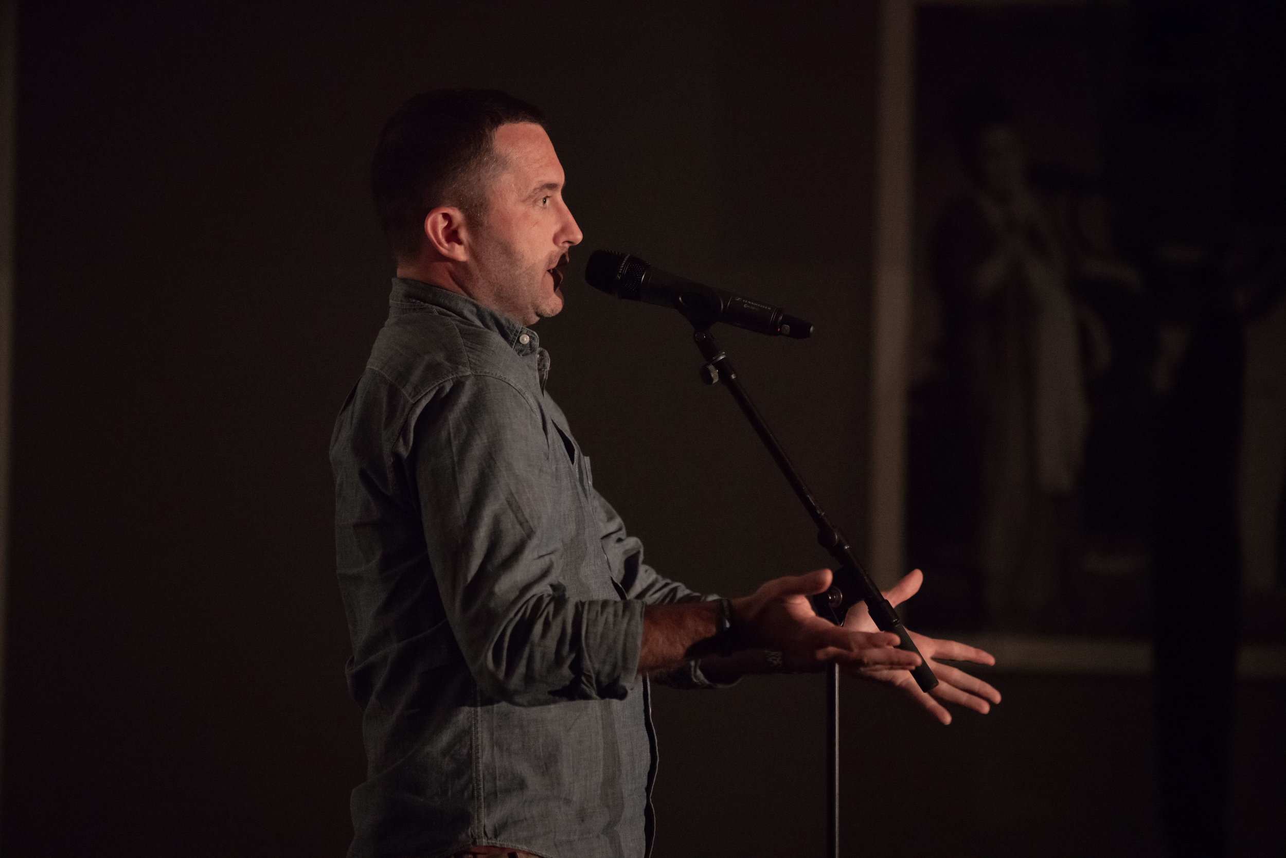 Luke Rosen shares his story with the Story Collider audience at The Little Nell in Aspen, CO in June 2019. Photo by Dale Ramos.