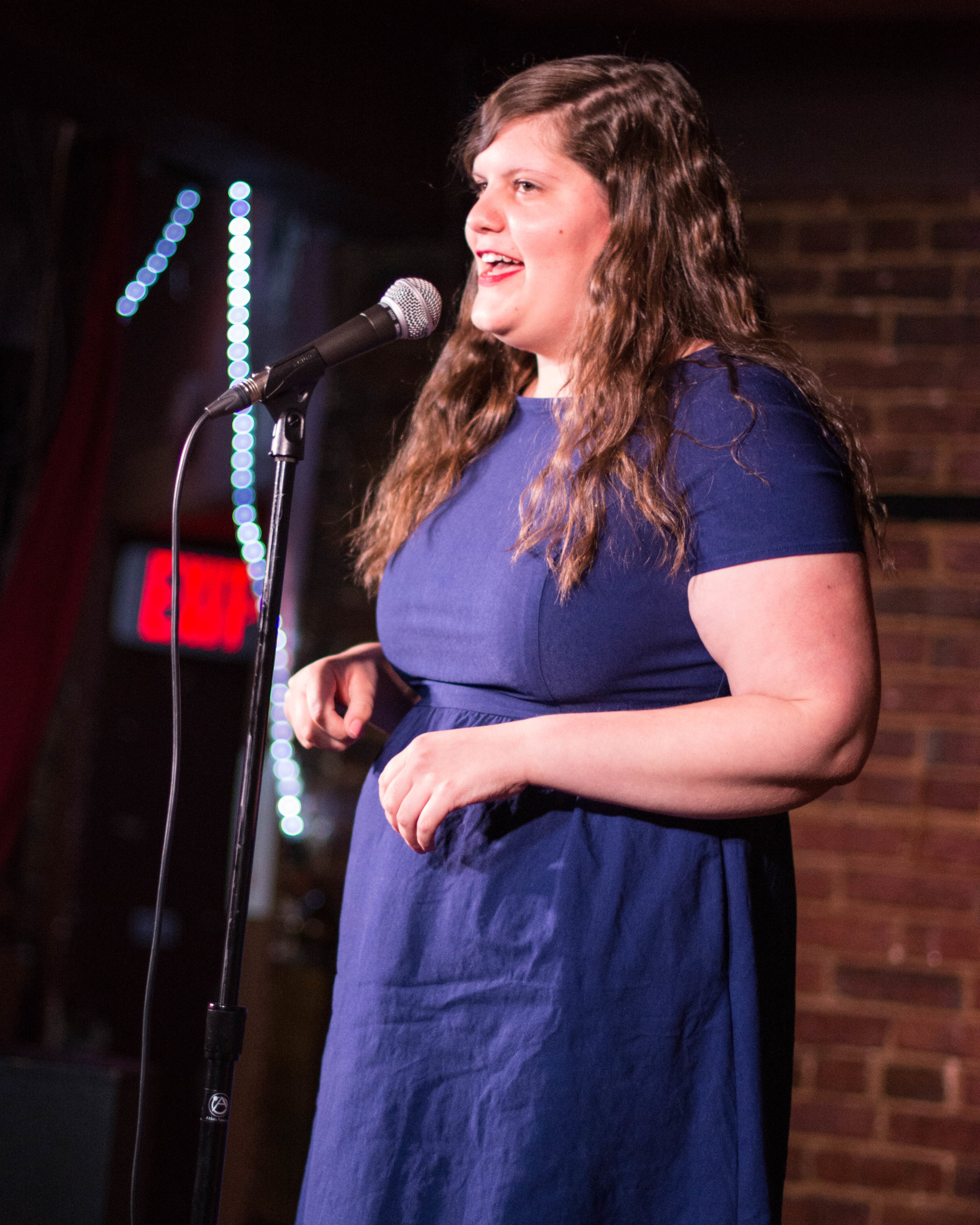 Jenn Montooth shares her story with the Story Collider audience at the Beir Baron Tavern in Washington, DC in June 2019. Photo by Lauren Lipuma.