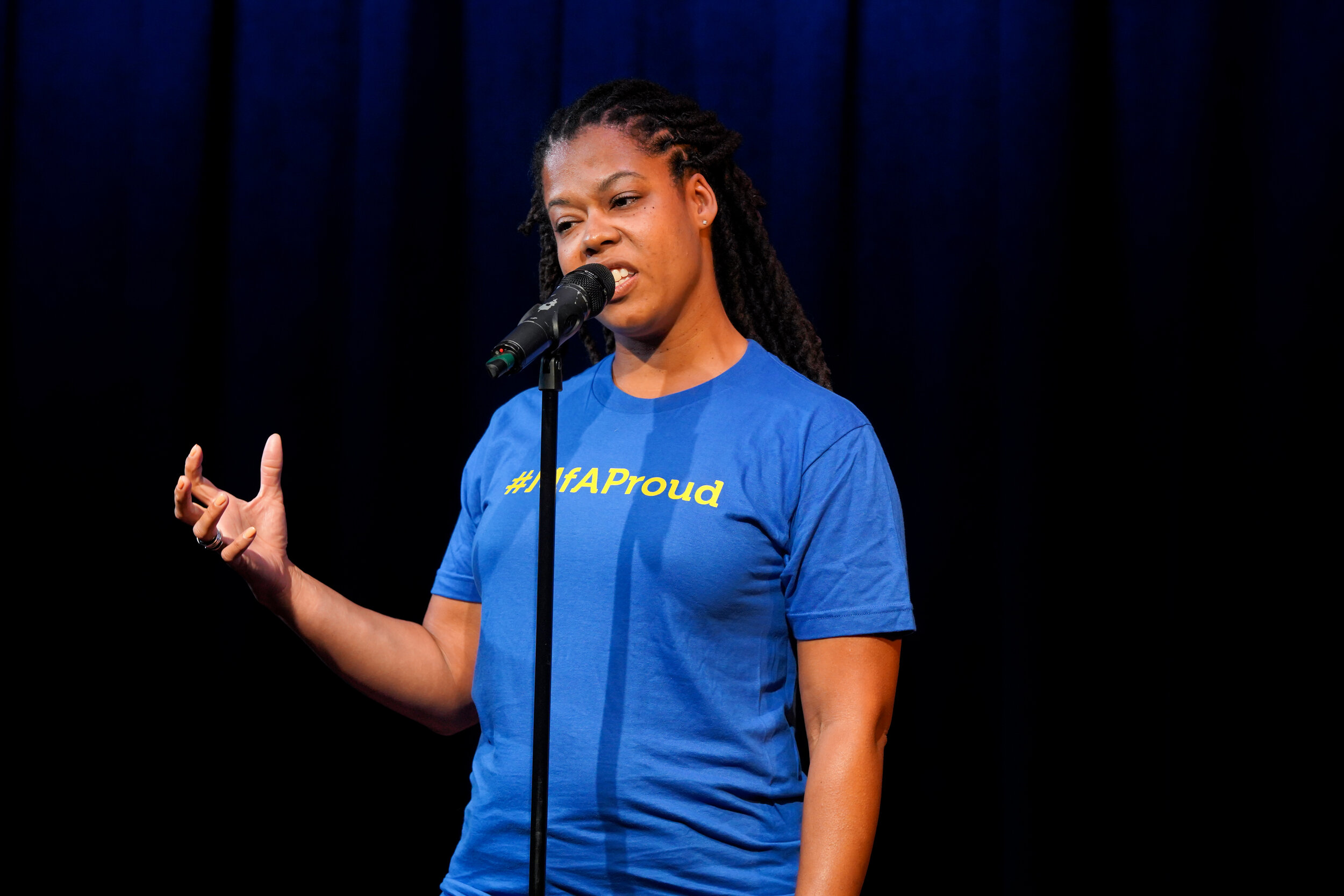 Aida Rosenbaum shares her story with the Story Collider audience at a show presented in partnership with Math for America at Caveat in New York City in May 2019. Photo by Zhen Qin.