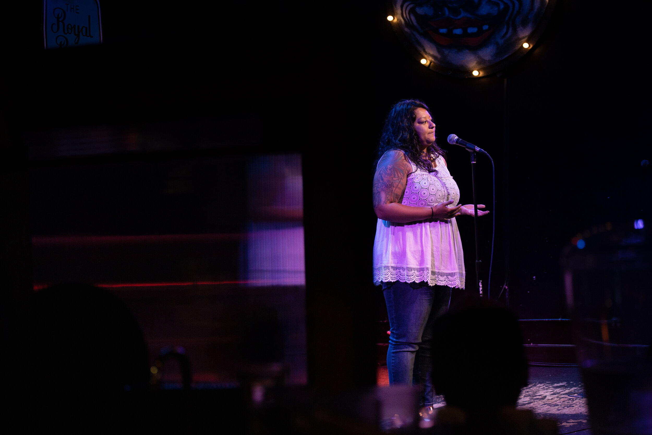 Lylliana Allala shares her story with the Story Collider audience in the Royal Room in Seattle, WA in June 2019. Photo by Elizar Mercado.