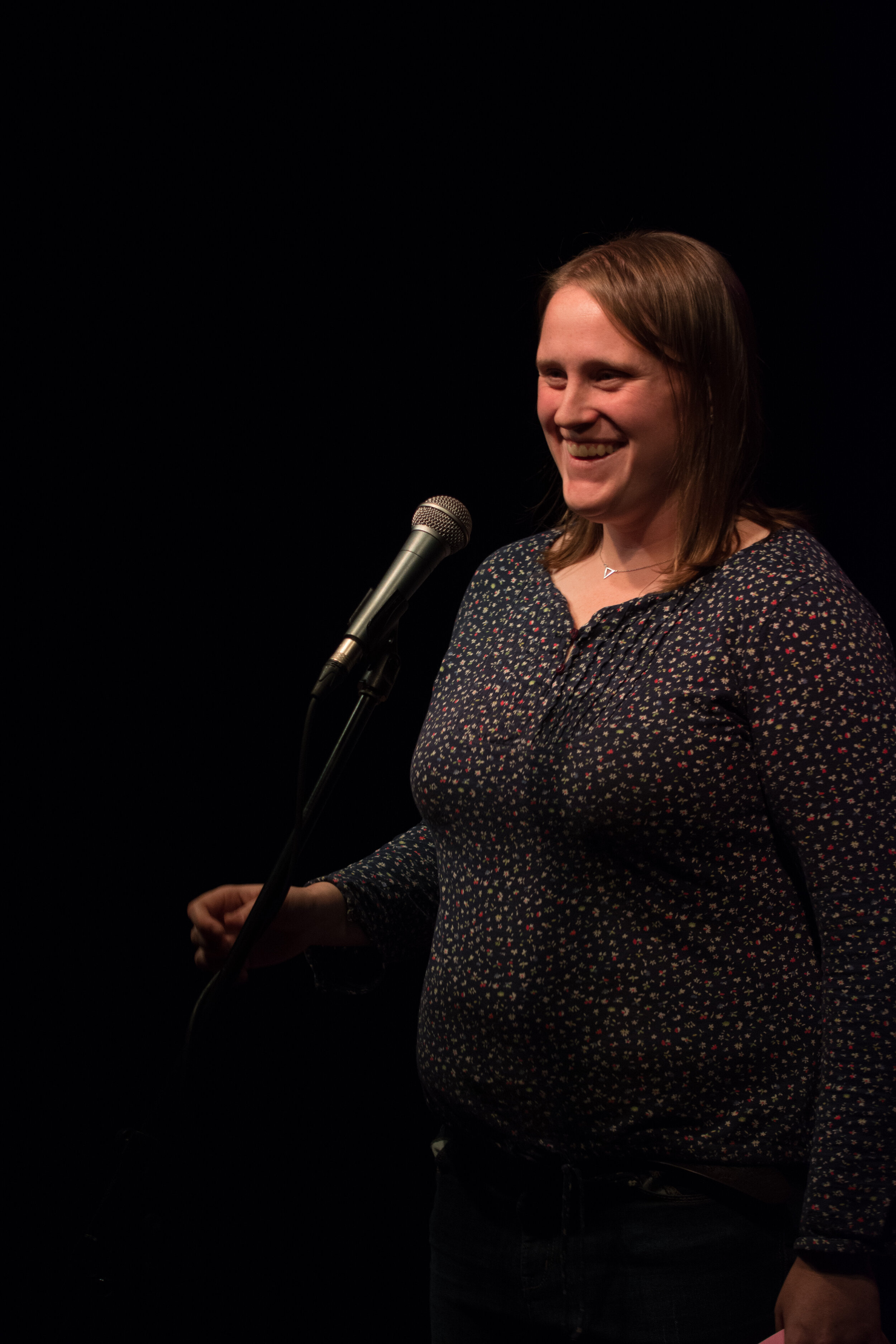 Vicky Forster shares her story with the Story Collider audience at the Burdock in Toronto, ON in October 2018. Photo by Stacey McDonald.