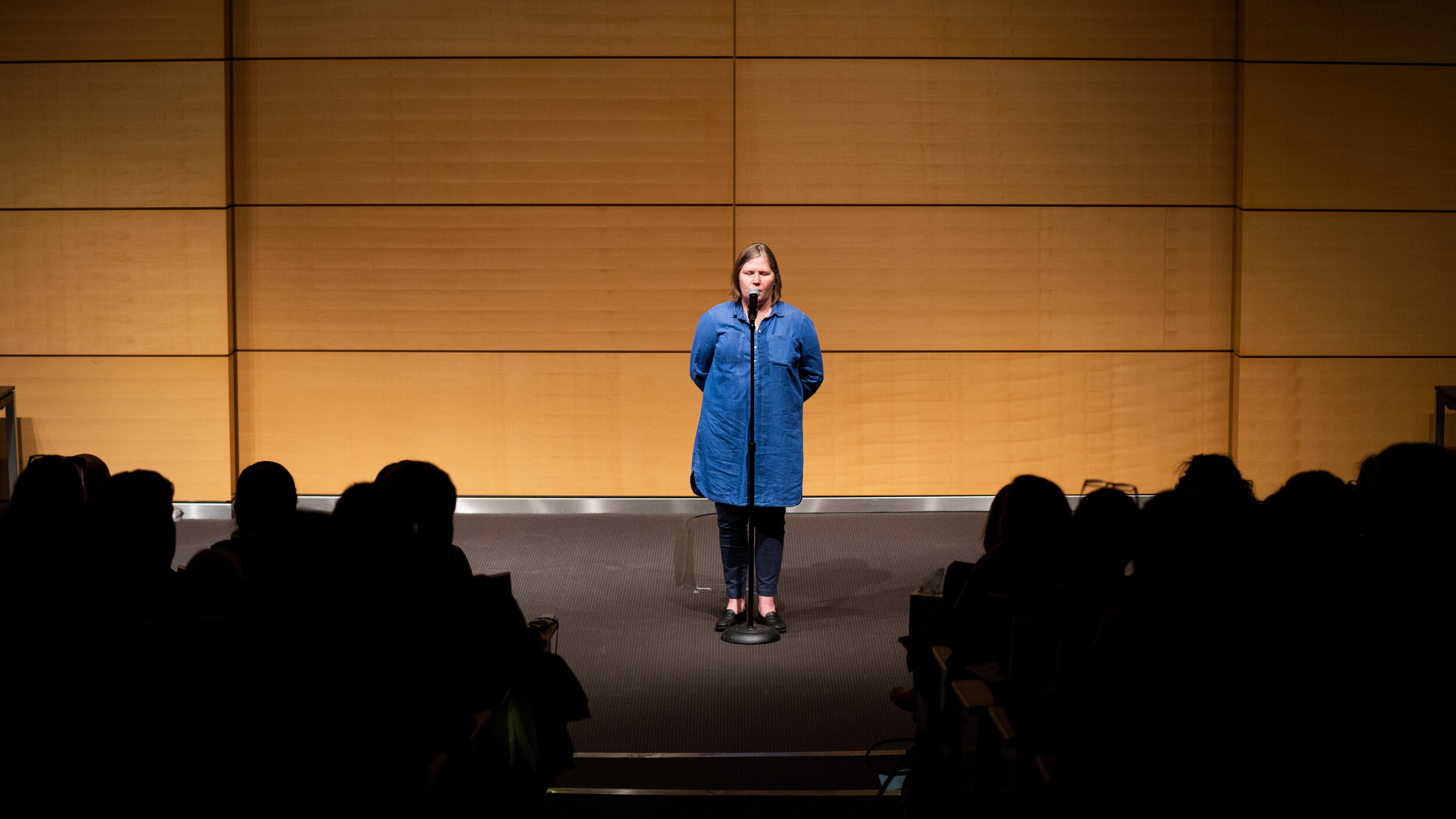 Kristine Lycke shares her story with the Story Collider audience as a show presented in partnership with Memorial Sloan Kettering in New York City in December 2018. Photo by Zhen Qin.