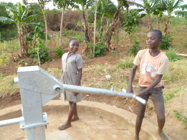 Kids draw water from a repaired well.