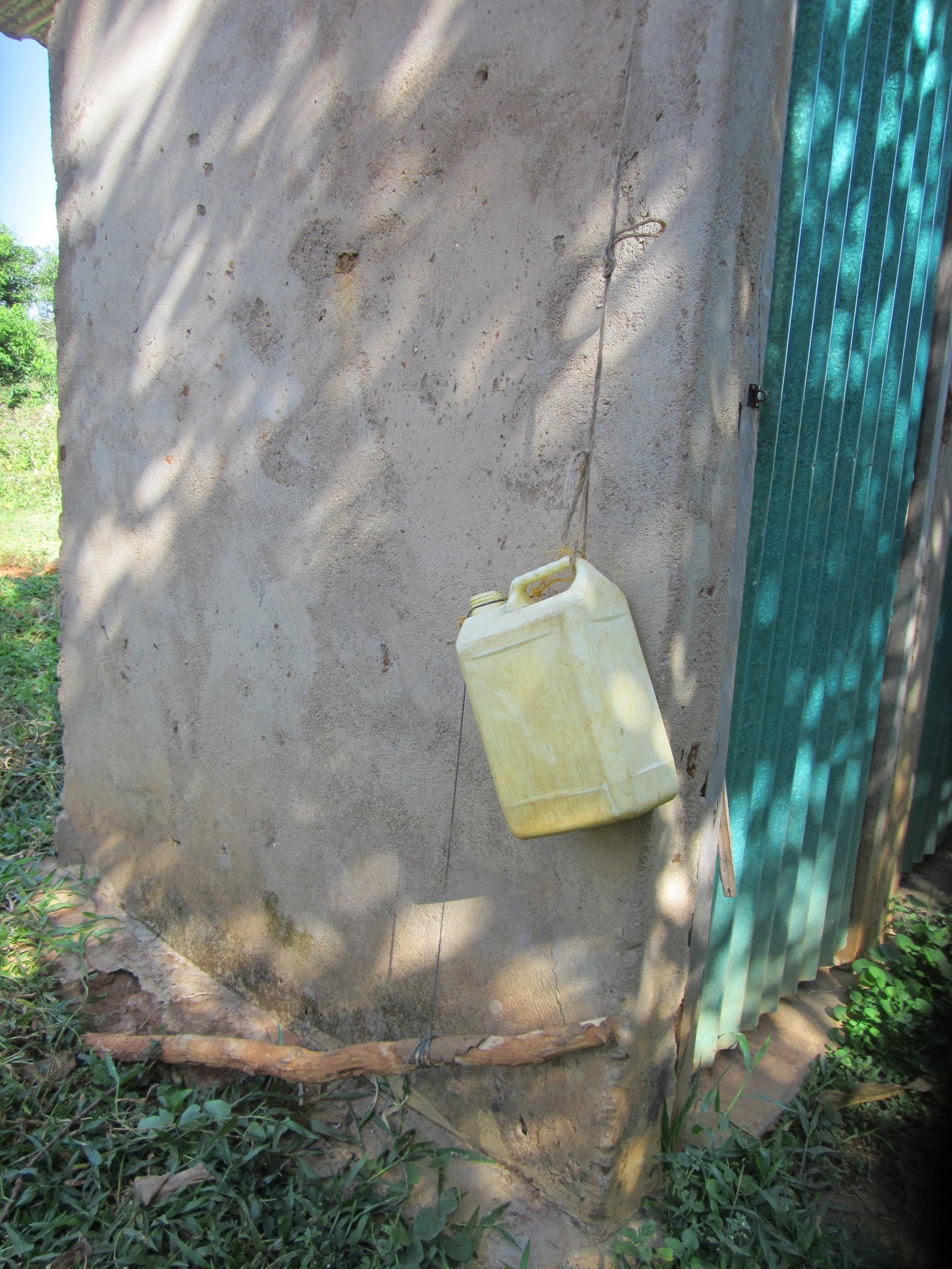 Water can for hand-washing outside of a latrine
