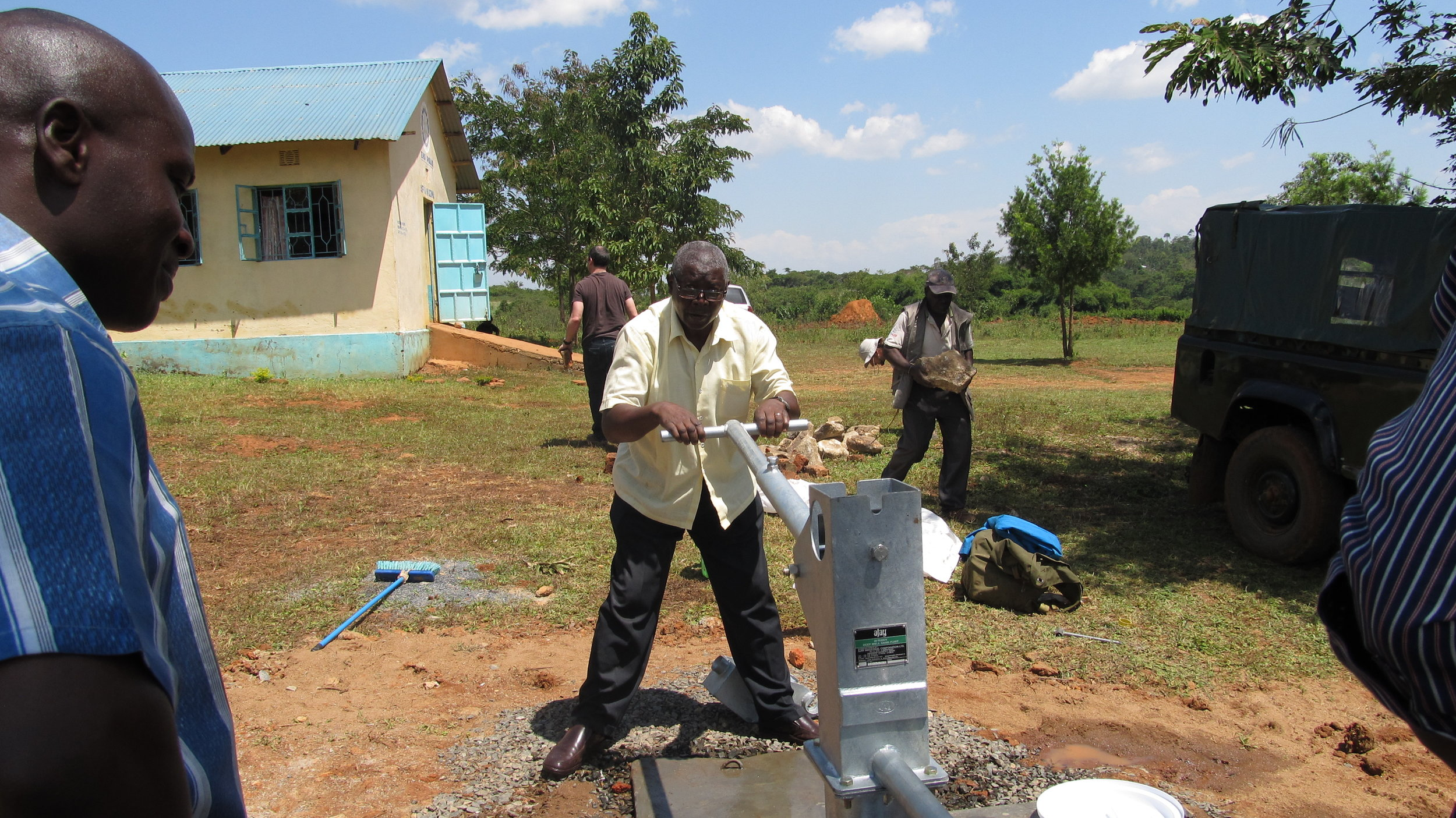 George pumping the new well.