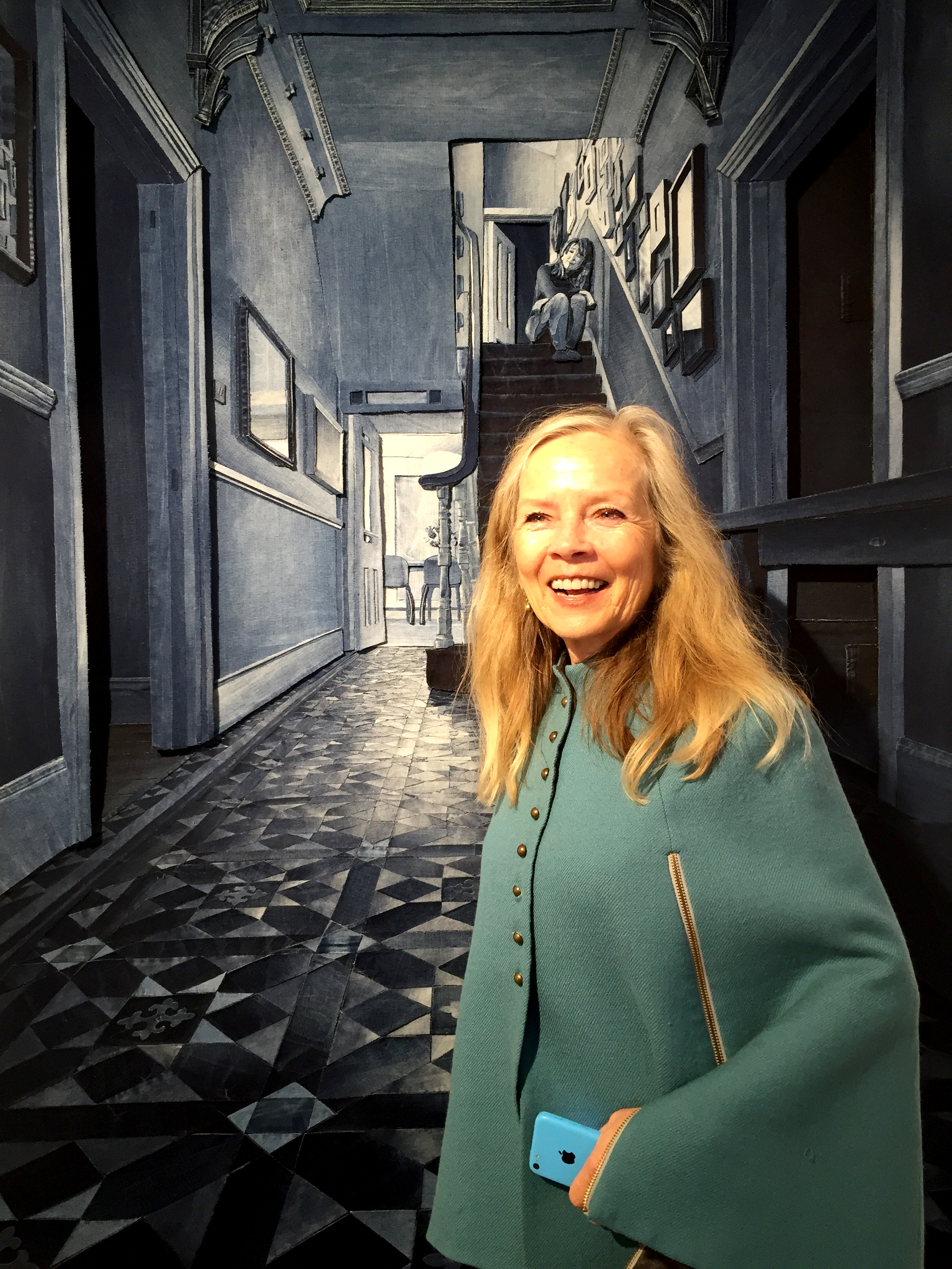 Jo Good with Ian Berry's piece Behind Closed Doors