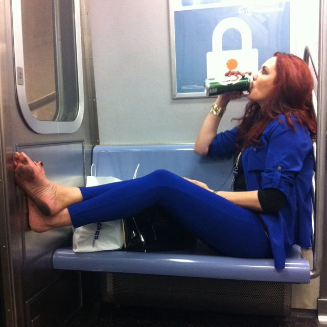"""Got a Girl Crush On: Giving zero f*cks       We tend to rag on    rude subway riders  , but the truth is that underneath every stylish, well-heeled New York woman is this lady, who frankly sees no reason to wait until she gets home to start enjoying some shoeless quality time with a cold one.    There's a lot to admire about this woman—her """"don't give a fuck"""" attitude and the impressive pile-up of filth blanketing her feet. The lanyard around her neck and dead-eyed gaze indicate that she probably just got off of work, and who doesn't need a tall can of Becks after doing that for 8 or 9 or possibly 10 hours per day, amirite?   Don't let haters get you down, girl. You're a beer-guzzling, dirty-footed inspiration to all of us."""