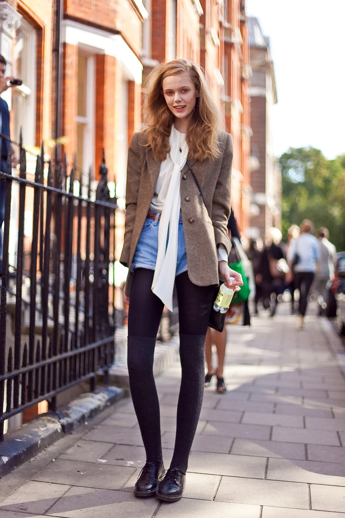 Got a girl crush on: Frida Gustavsson    It's hard to tell in this photo, but Swedish model Frida is actually wearing long socks over her tights. I'm digging this subtle monochrome legwear combination, especially done under a pair of jean shorts.   (via  altamira )