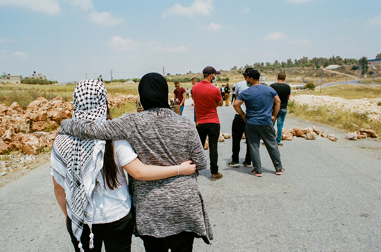 Palestinian women from the village of Nabi Saleh on the front lines during the demonstration protesting the Israeli occupation and neighboring settlement that took over the village's natural water source in 2009. These demonstrations typically occur every week on Fridays when the Israeli military closes down the road into the village.