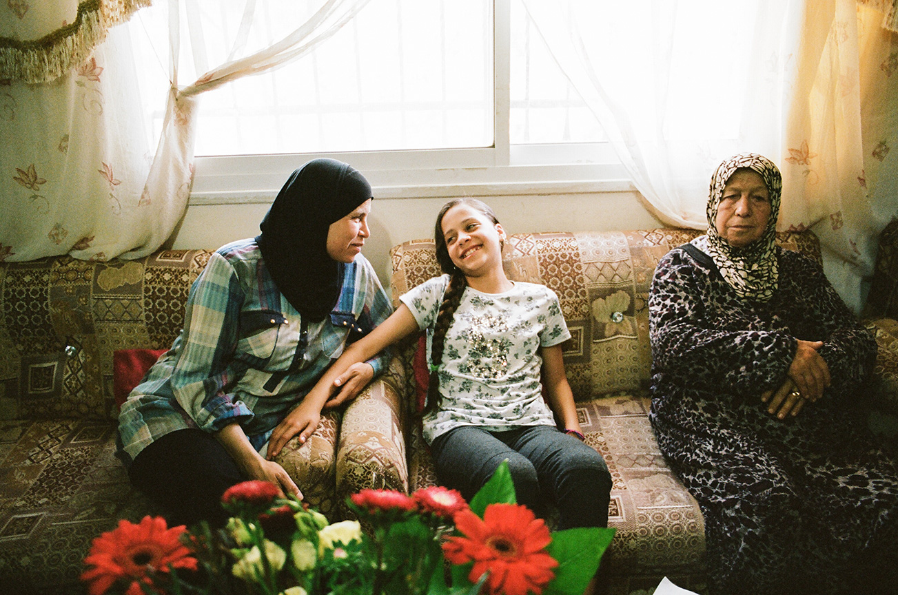 Janna with her mother Nawal and grandmother at home in Nabi Saleh. Janna tells her mother all about her upcoming final exams at school that she's nervous about and how she's very excited about spring break.