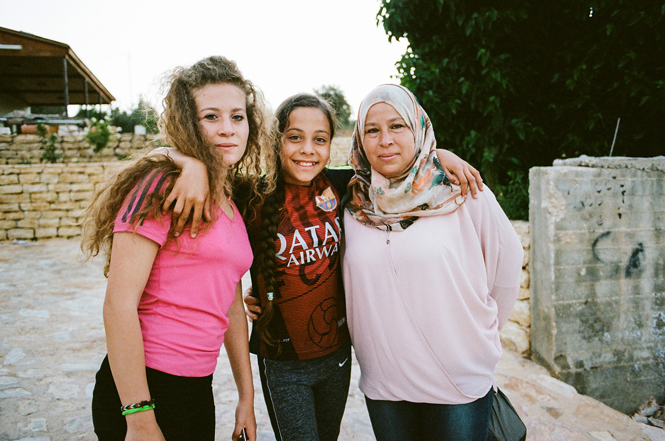 (left to right) Ahed Tamimi, Janna Ayyad, and Ahed's mother Nariman outside of their home in the village of Nabi Saleh, West Bank, Palestine.