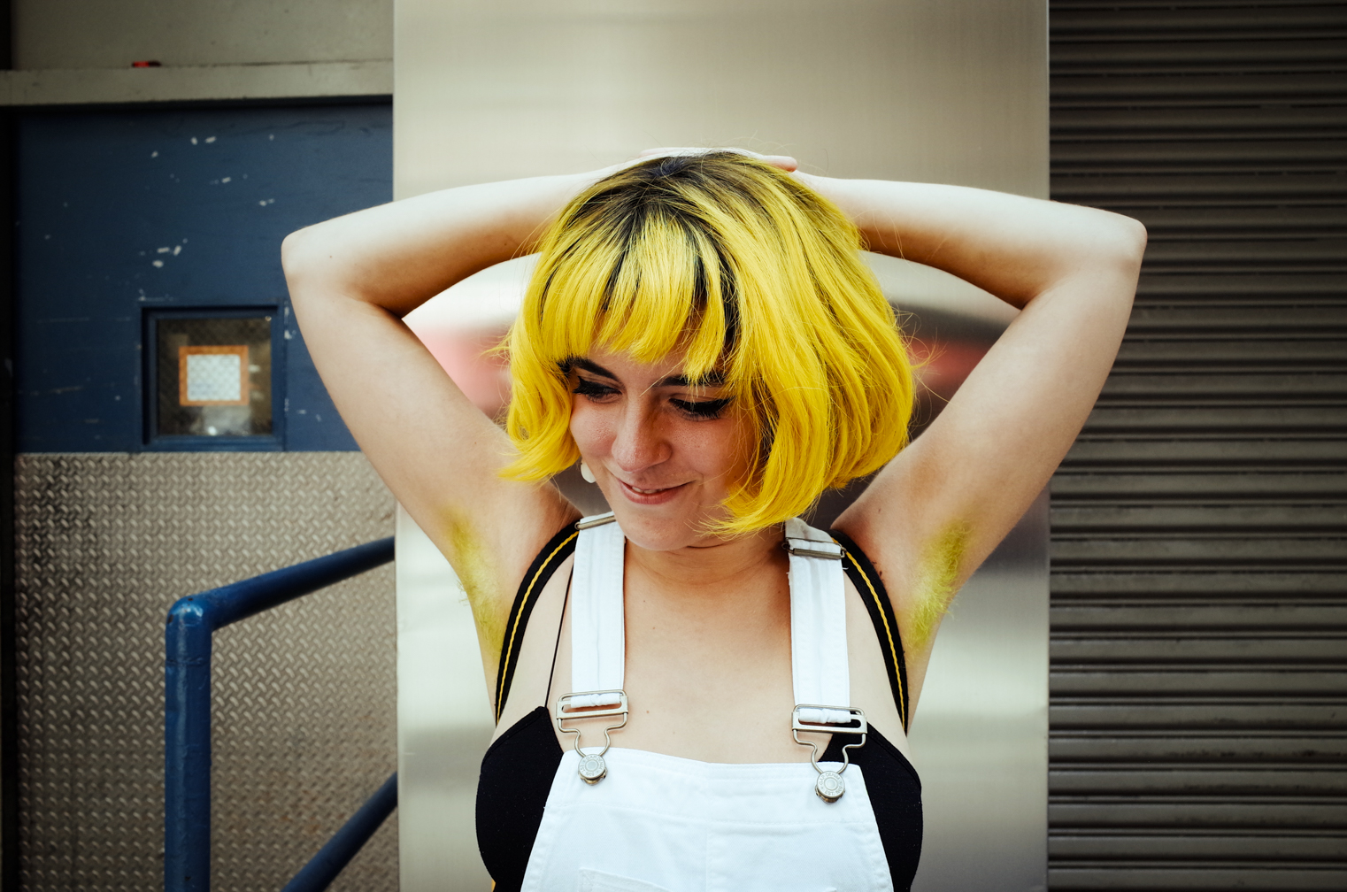 """Tink rocking freshly dyed pit hair in Manic Panic's """"Electric Lizard"""""""
