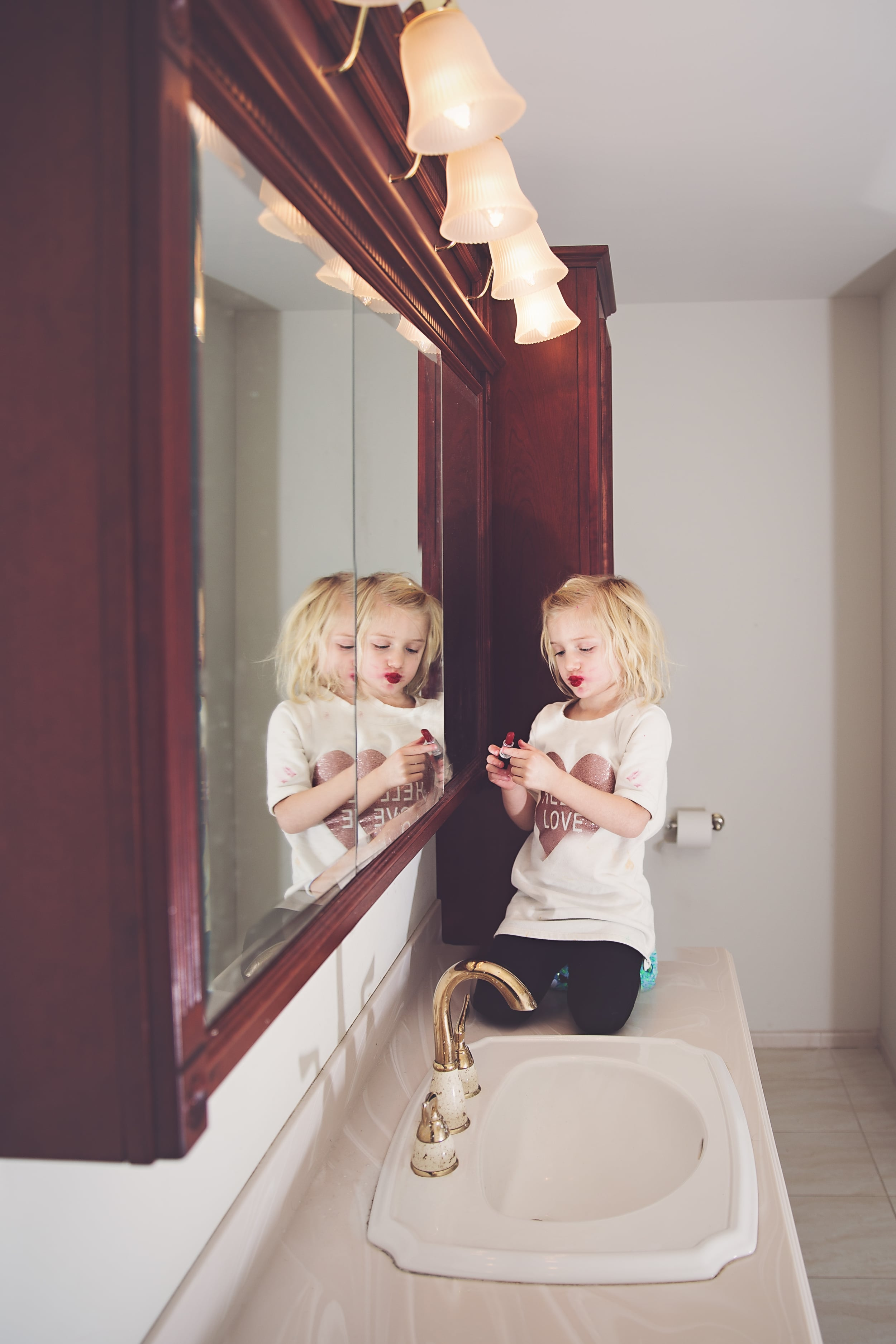 Hello-Olivia-Photography-suffolk-county lifestyle-childrens-photographer-red-lipstick-child-wearing-mom-make-up.jpg