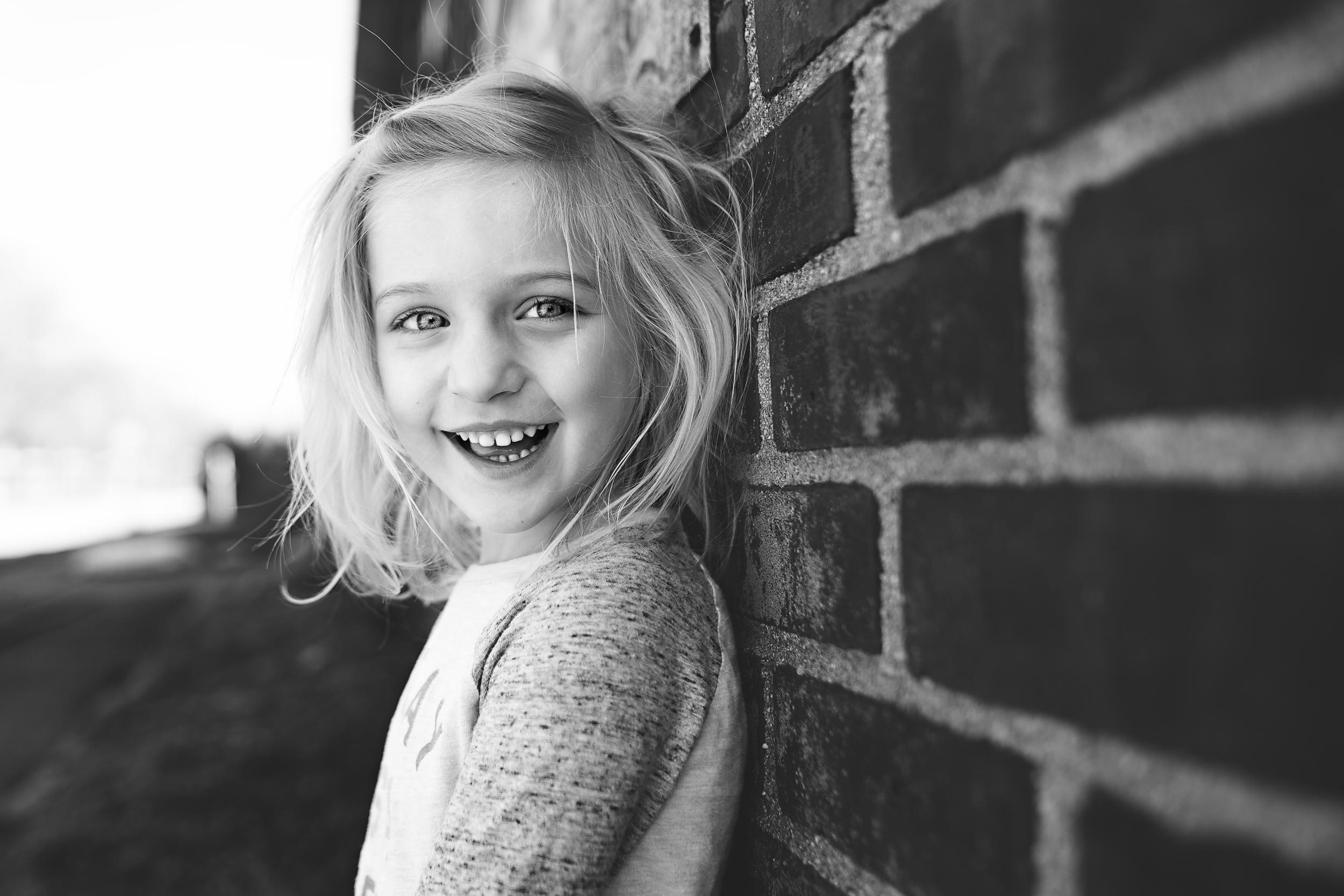 Hello-olivia-photography-long-island-family-photographer-childrens-museum-hempstead-brick-wall.jpg