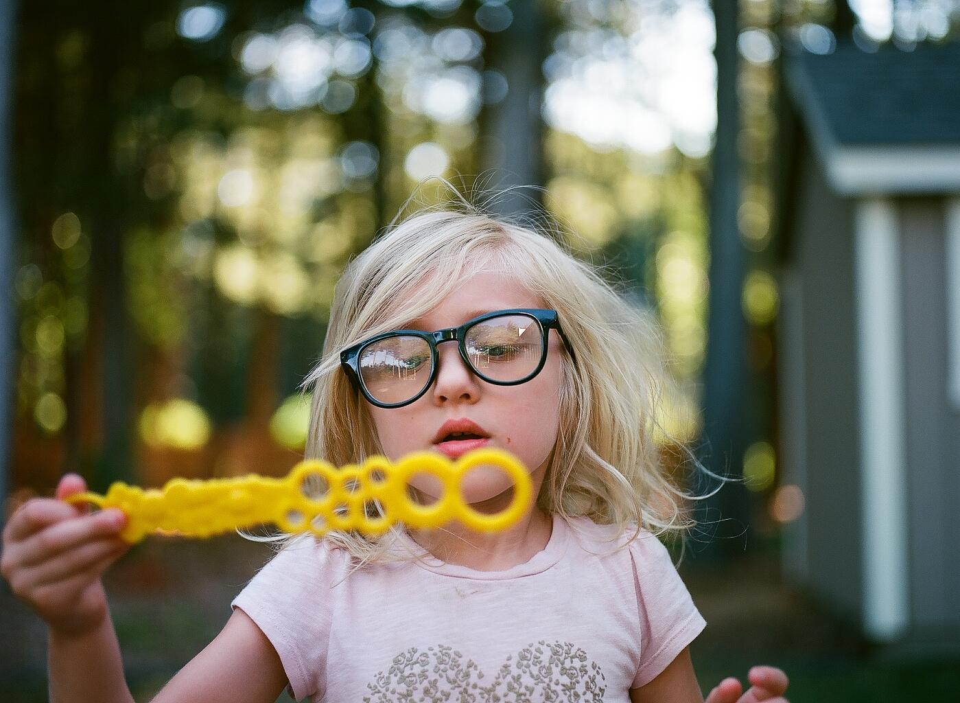 hello-olivia-photography-long-island-film-photographer-yellow-bubble-wand.jpg