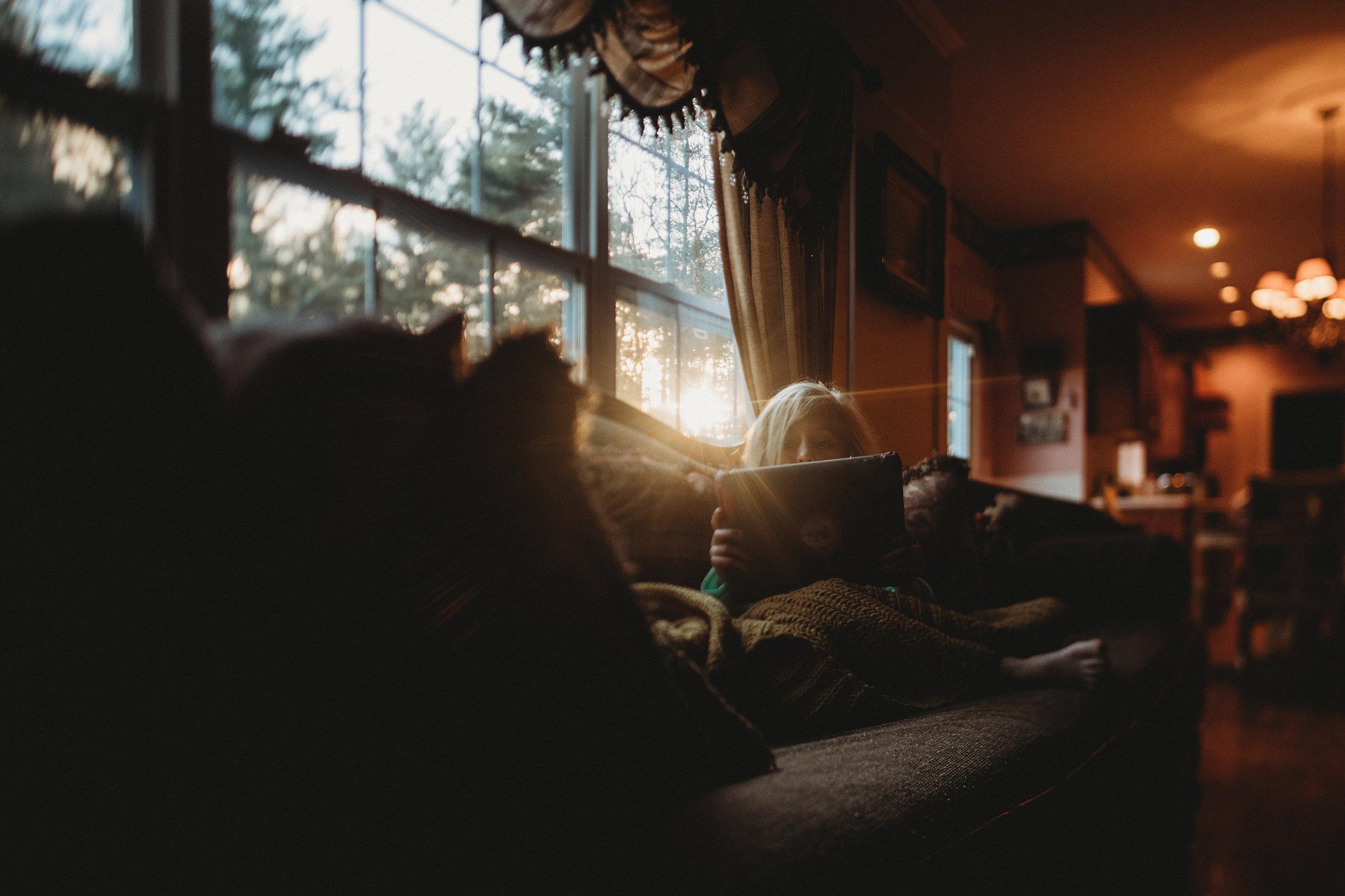 hello-olivia-photography-long-island-photographer-lifestyle-suffolk-light-flare-couch-sun-shine.jpg