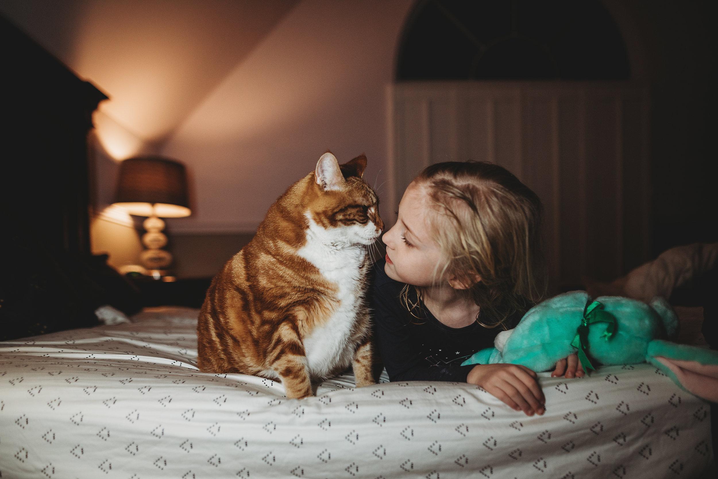 hello-olivia-photography-long-island-photographer-lifestyle-child-kiss-cat-girl-love-pet-animal.jpg
