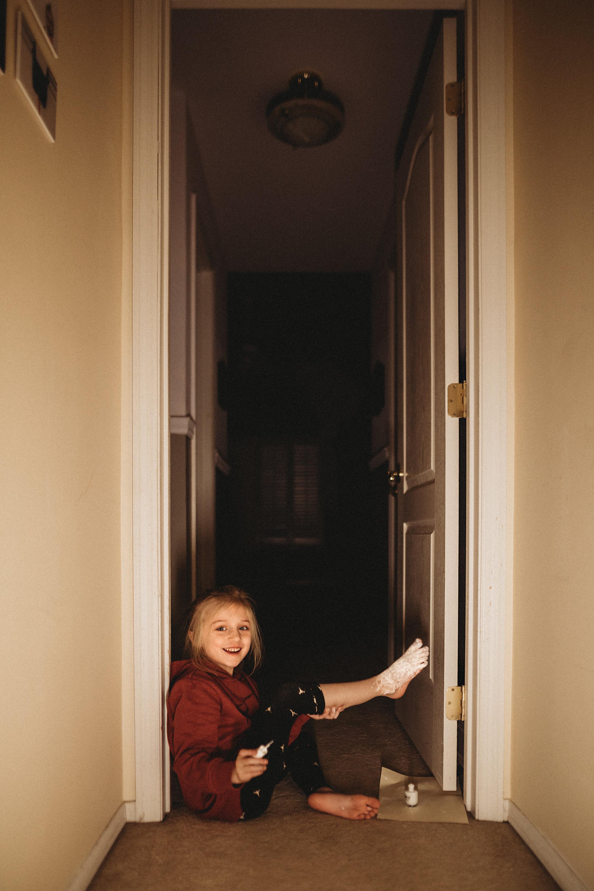 hello-olivia-photography-long-island-photographer-lifestyle-child-painting-foot-white.jpg