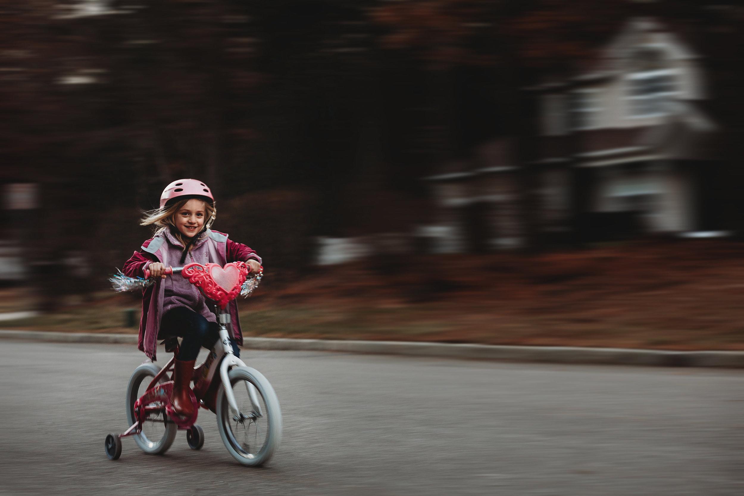 hello-olivia-photograph-long-island-photographer-family-little-girl-riding-bike-panning
