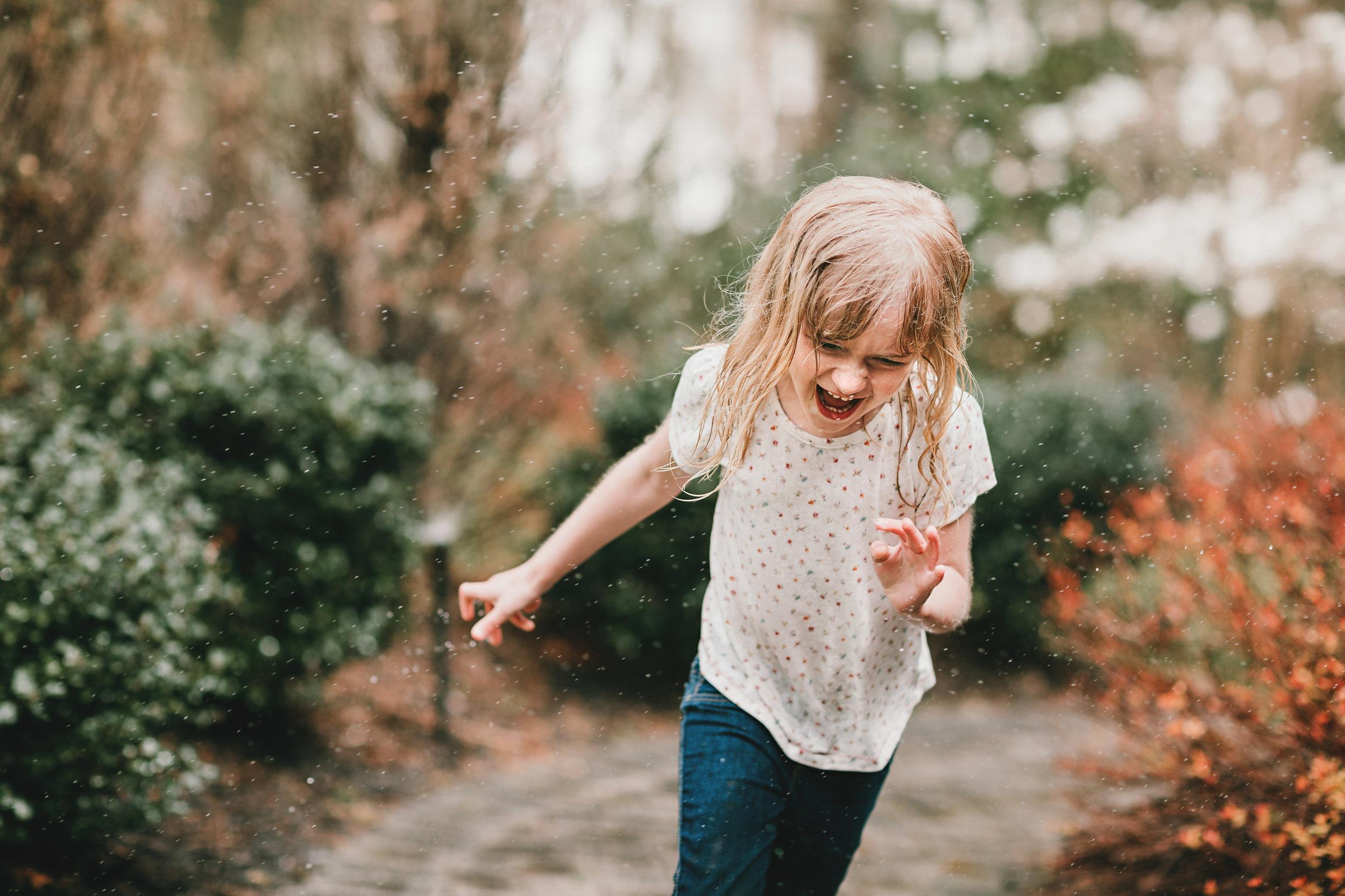 Hello-olivia-photography-long-island-photographer-children-lifestyle-running-through-sprinkler.jpg