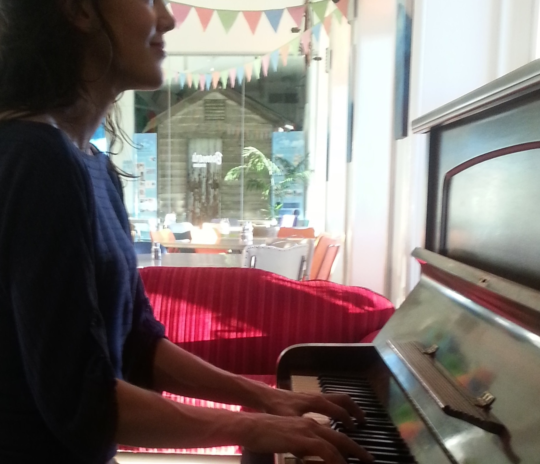 MT at Piano in Boomers Cafe.jpg