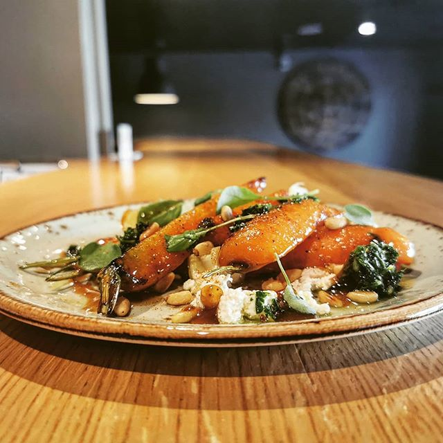 "Chef says ""be a good boy and eat your veggies"" Lester's farms carrots, maple + miso caramel, caramelized yogurt, olive oil poached lemon, carrot top gremolata, toasted pine nuts."