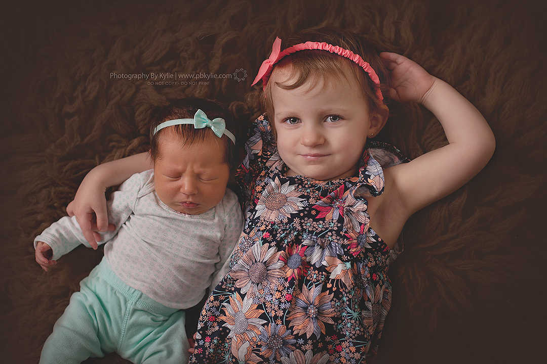 Emily, 7 days old. Abigail, 22 months old.