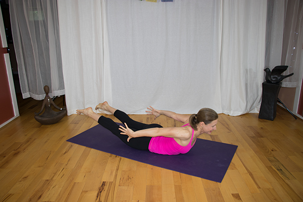 Strengthen your lower back with yoga and avoid back pain. Locust Pose variation. www.irenamiller.com