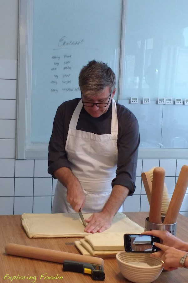 Our instructor Frederic Terrible cutting for us some laminated dough for croissant rolling. (Our course started backwards as we started with rolling/folding the dough and putting the croissants to proof for 3 hours and then laminated croissant dough by ourselves.)