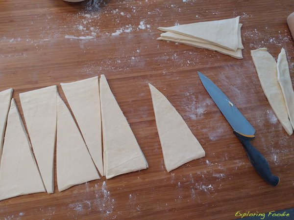 Cutting some triangles. Every croissants starts its life as a triangle :)