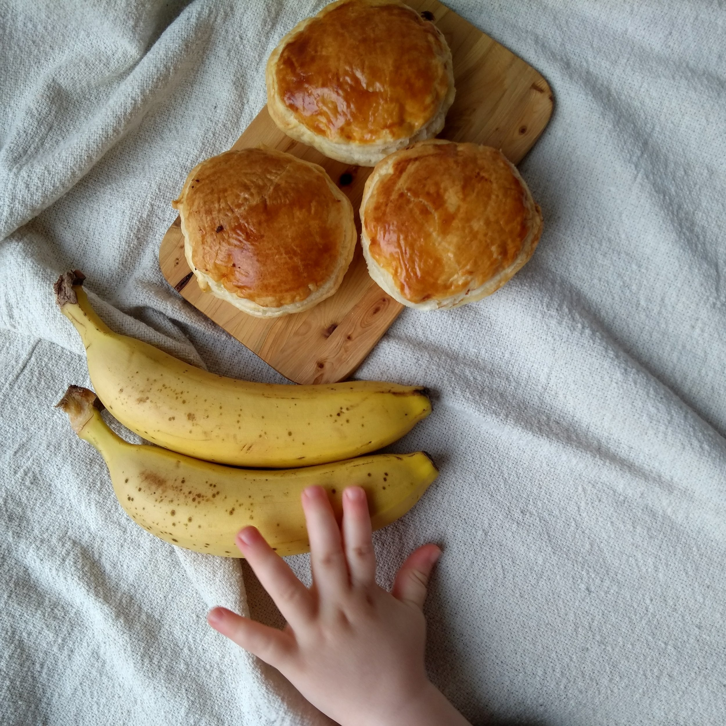 Little hand reaching to some more bananas and ricotta puffs