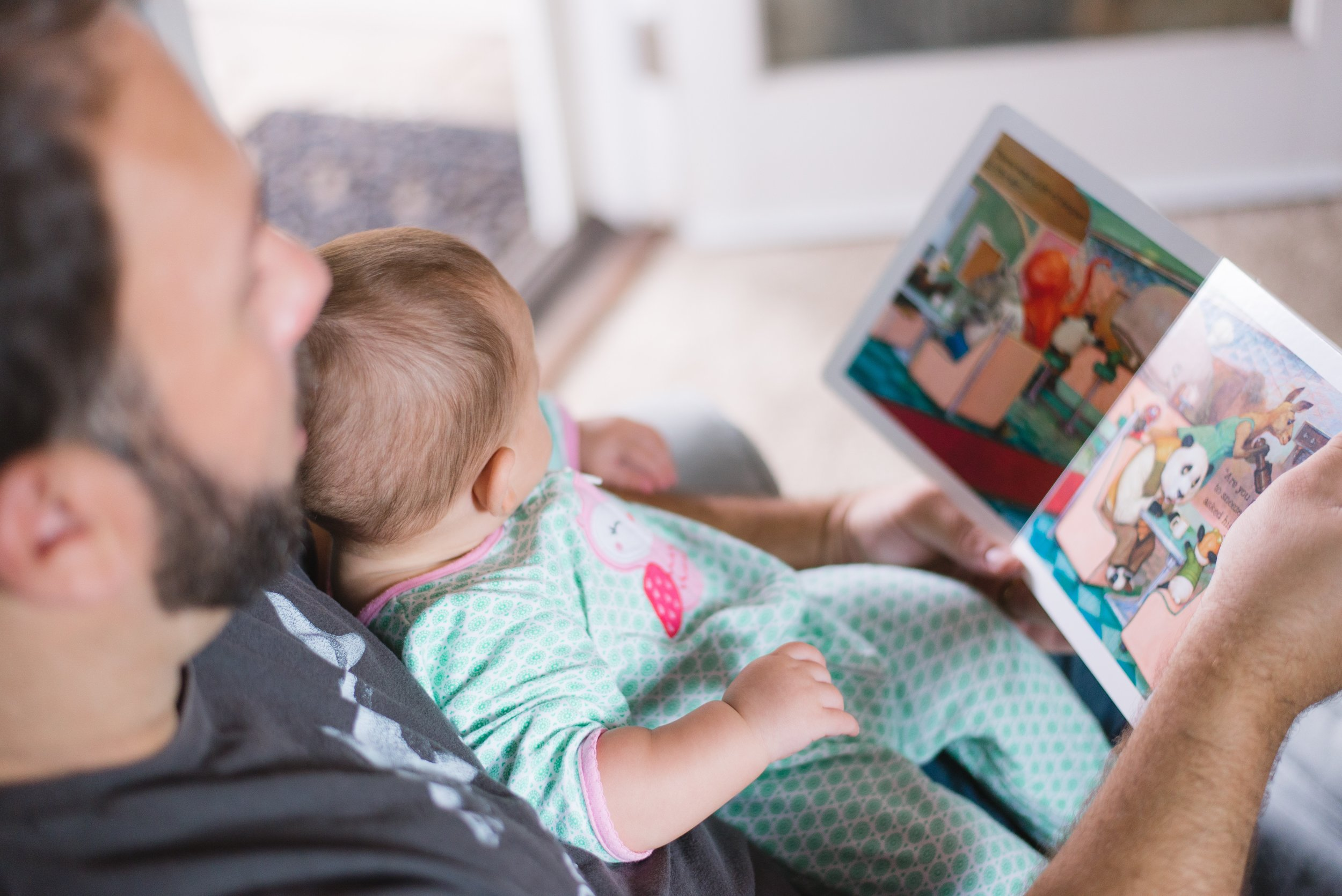 baby reading dad lending library birth postnatal doula services.jpg