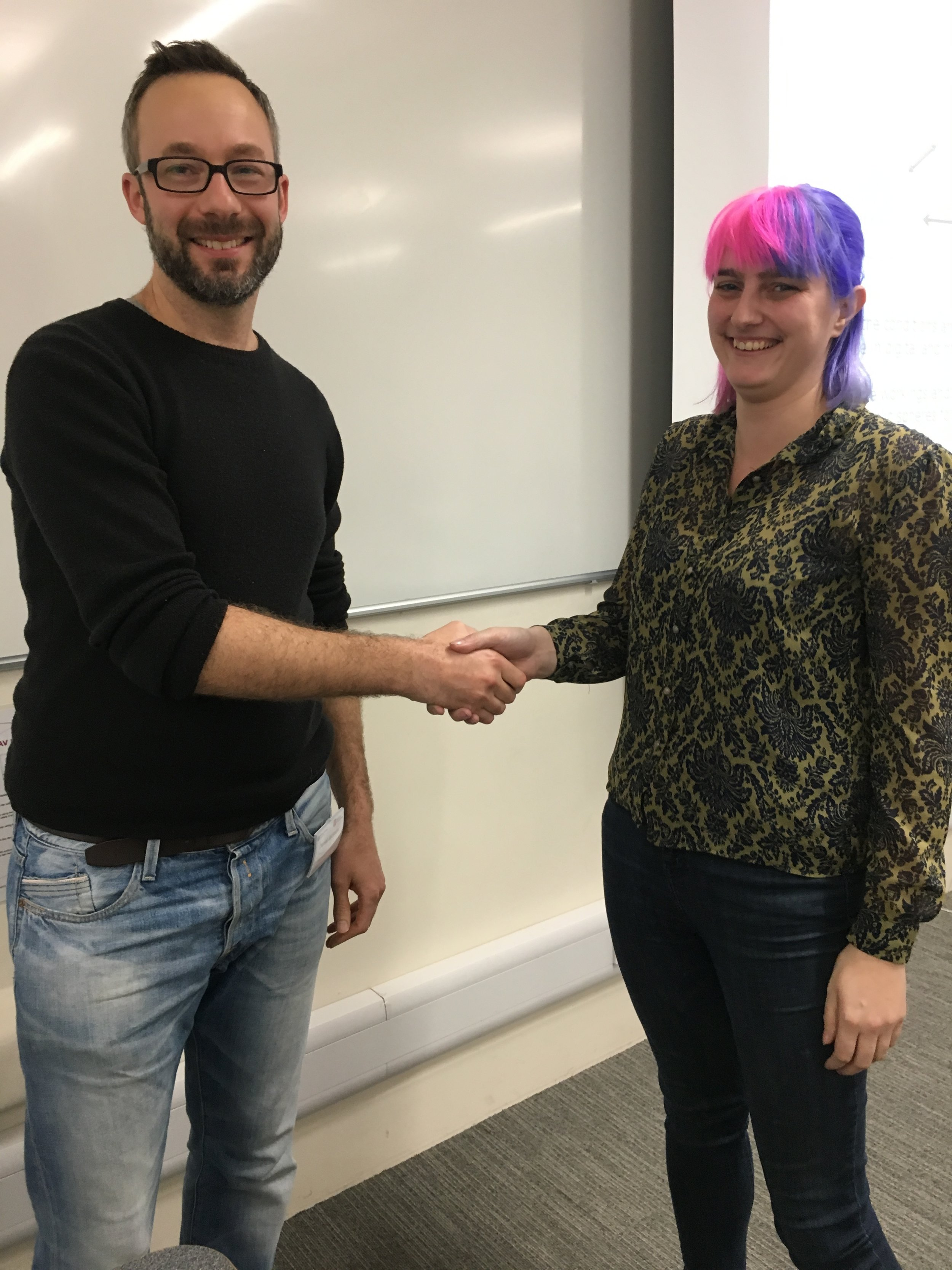 Dan Jackson, convenor of the PSA Media and Politics Group, congratulates Amber on her honorable mention.