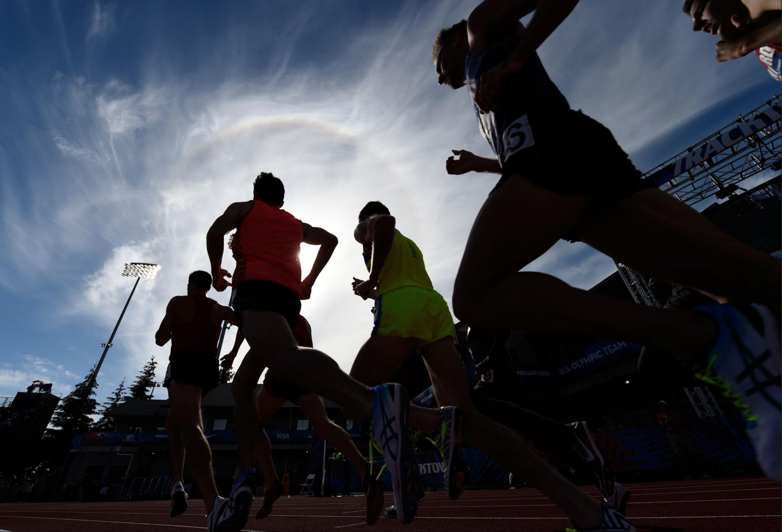 Competitors run in the men's 5,000-meter qualifying heats.